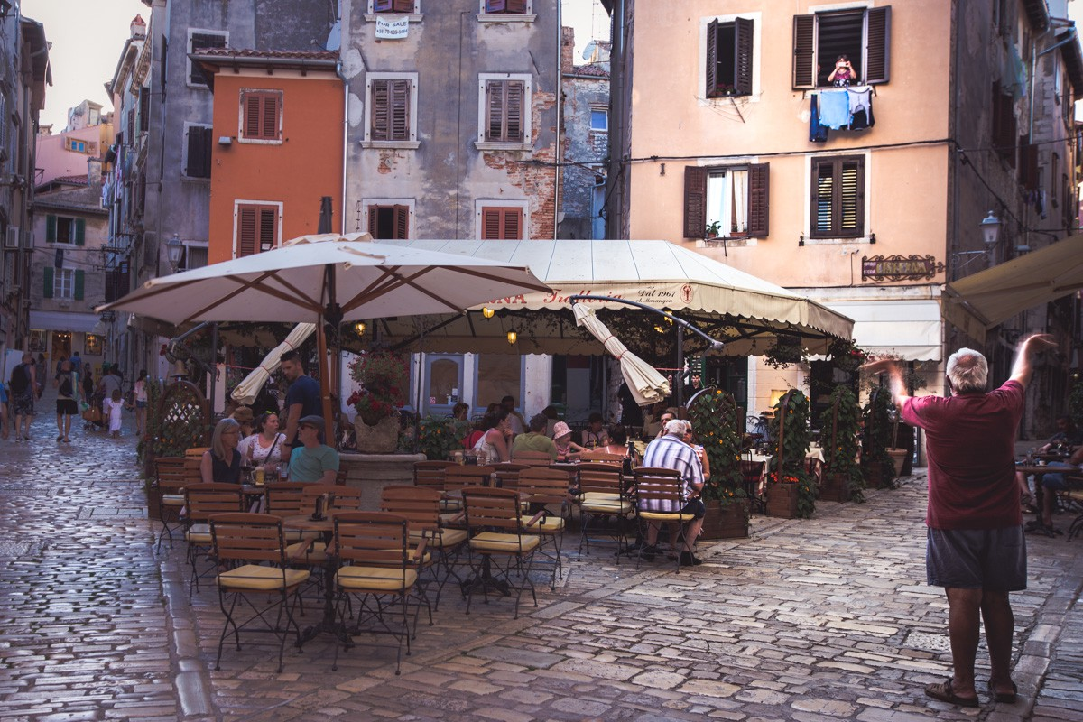 Being photographed from a window in the Venetian old town of Rovinj in the Istrian peninsula of Croatia
