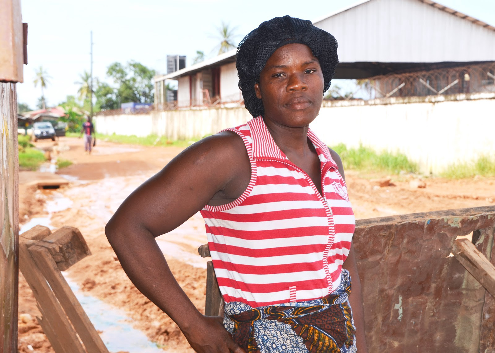 Naomi* was referred to USAID-supported psychosocial services after her husband died of Ebola. She's now a successful water vendor, a business that is helping her support her two small children. / Jessica Benton Cooney, USAID
