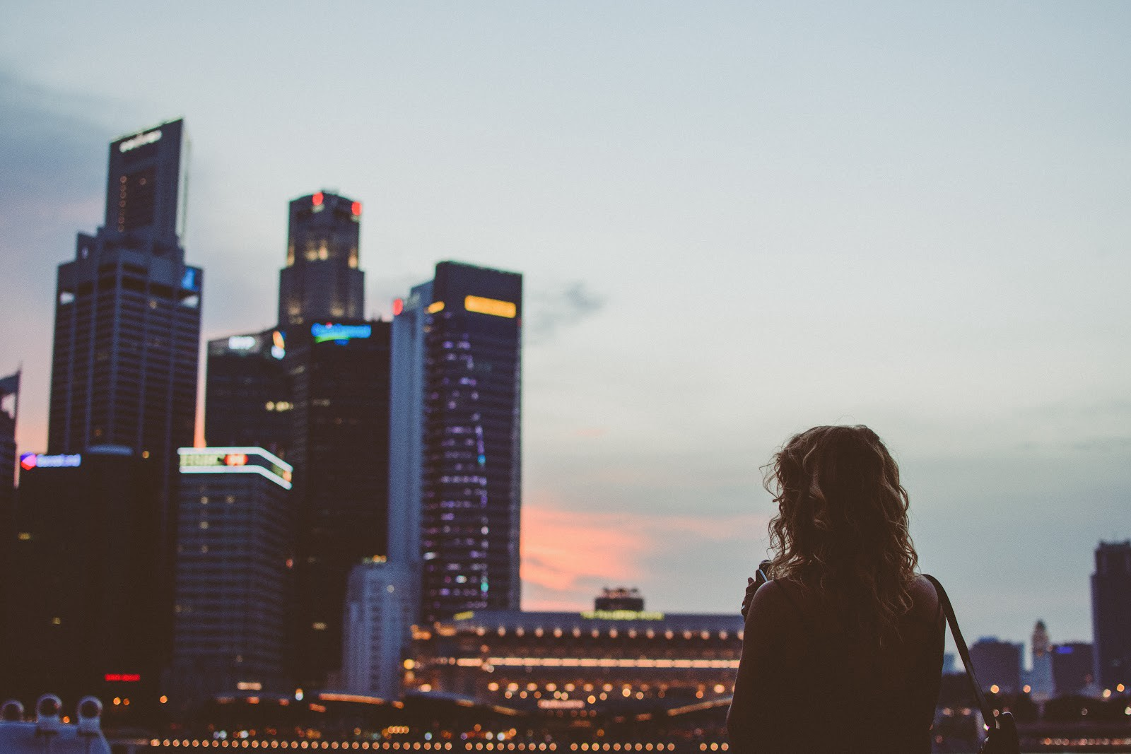 Woman Looking at Singapore Skyline