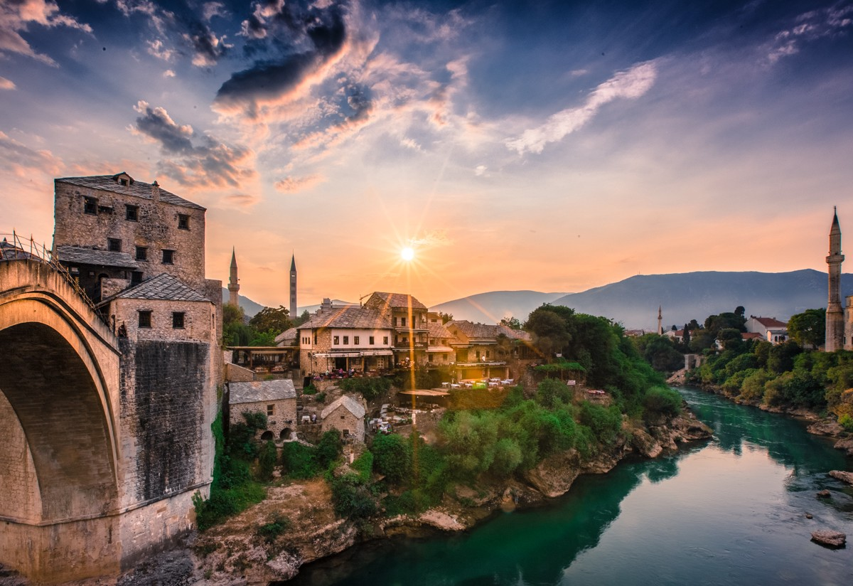 Sunset across the town of Mostar with it's numerous minarets, over the Neretva river