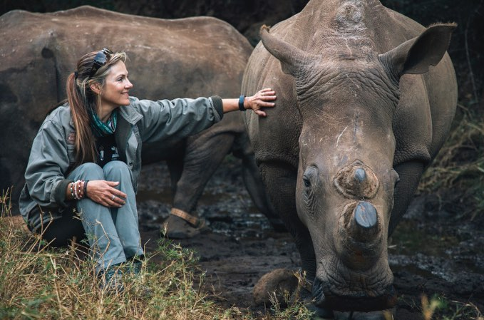 Petronel Nieuwoudt with one of the beloved white rhinos she is rehabilitating. Photo courtesy of Care for Wild.