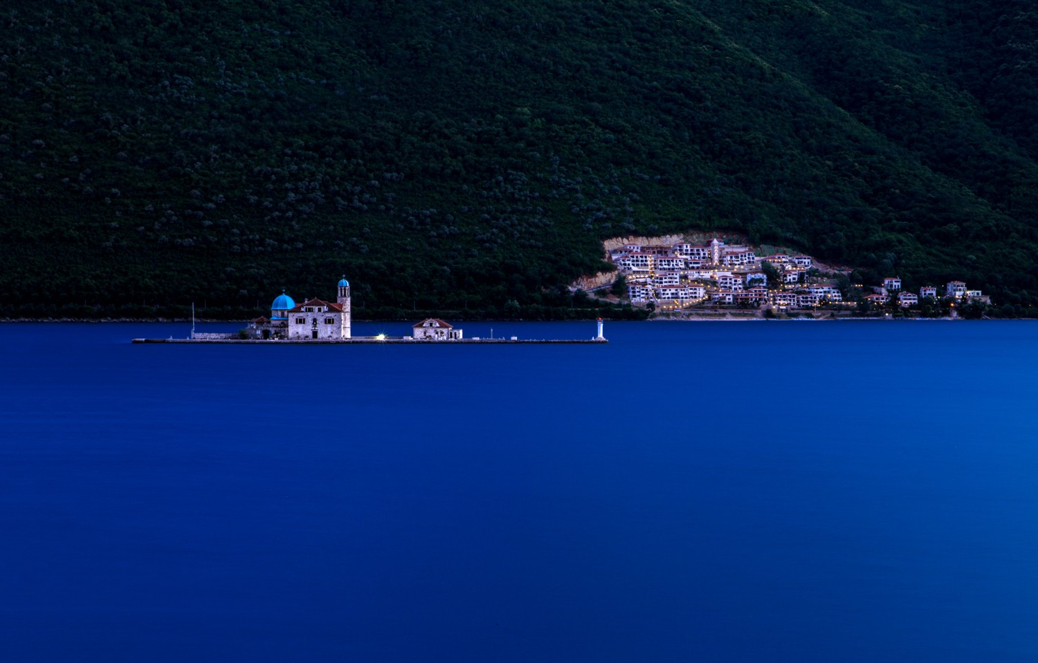 Our Lady of the Rocks church on an islet in Kotor Bay at dusk