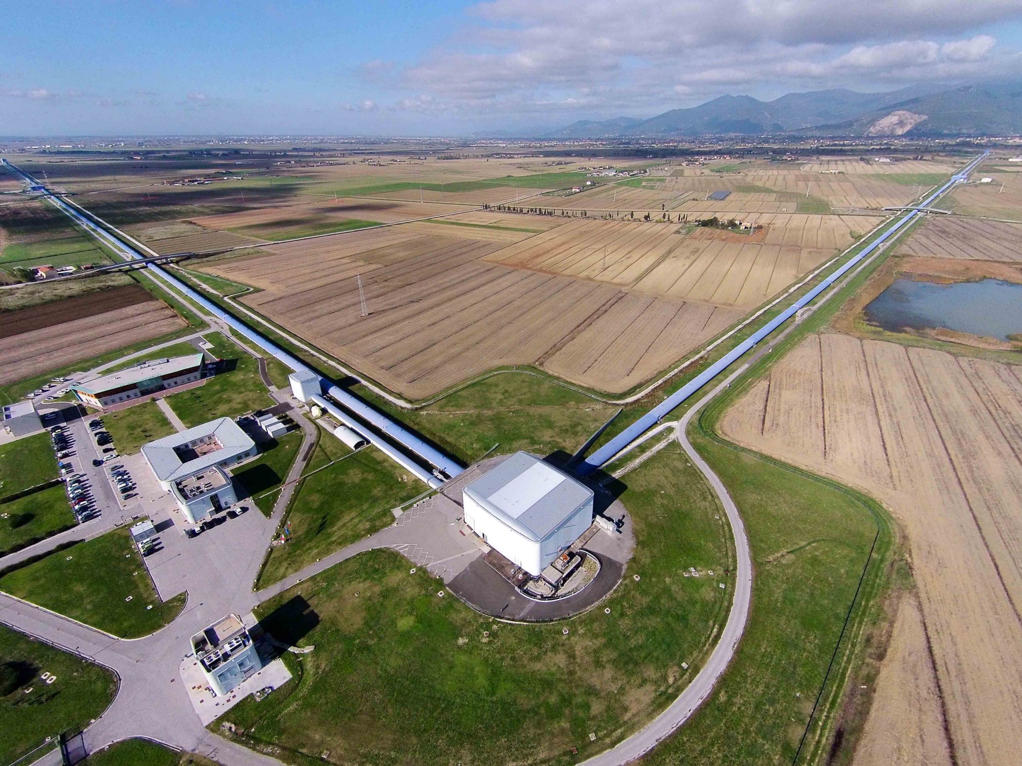 The VIRGO observatory in Italy has ultra-sensitive detection and measuring equipment to spot gravitational waves. Image credit – 'VirgoDetectorAerialView' by The Virgo collaboration is in the public domain