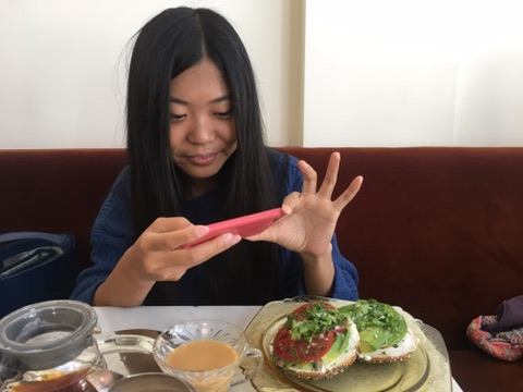 Gao taking a pic of the amazing food