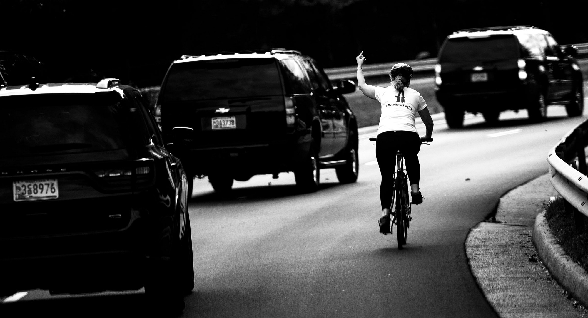 Cyclist who flipped off Trump's motorcade fired from her job
