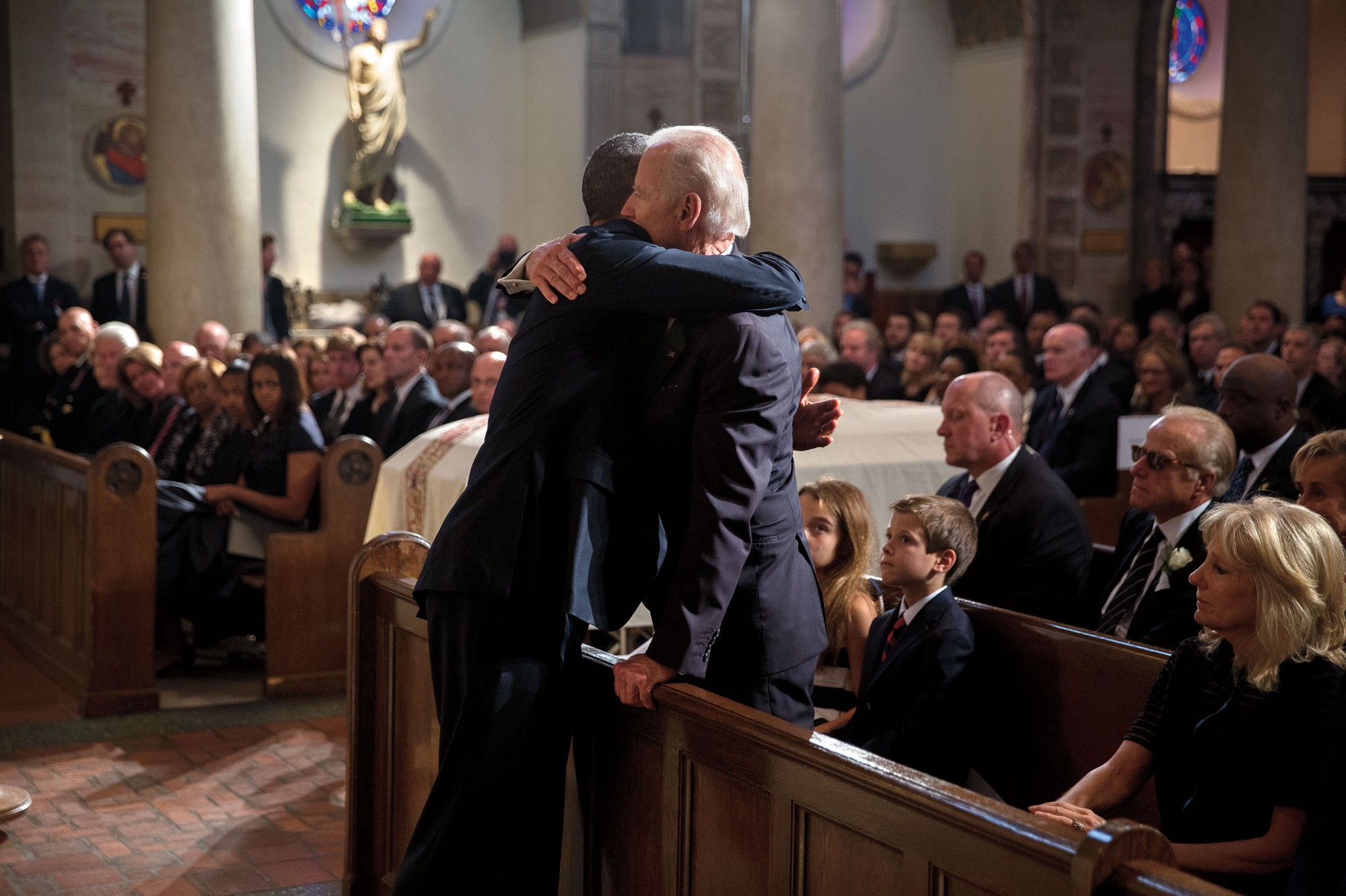 "June 6, 2015 ""The President hugs Vice President Joe Biden after delivering a eulogy during the funeral mass for Beau Biden at St. Anthony of Padua Catholic Church in Wilmington, Del."" (Official White House Photo by Pete Souza)"