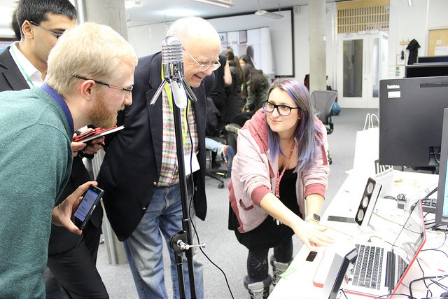 This is me (right) presenting my first hack to three judges at the science fair for HackNotts 2015.