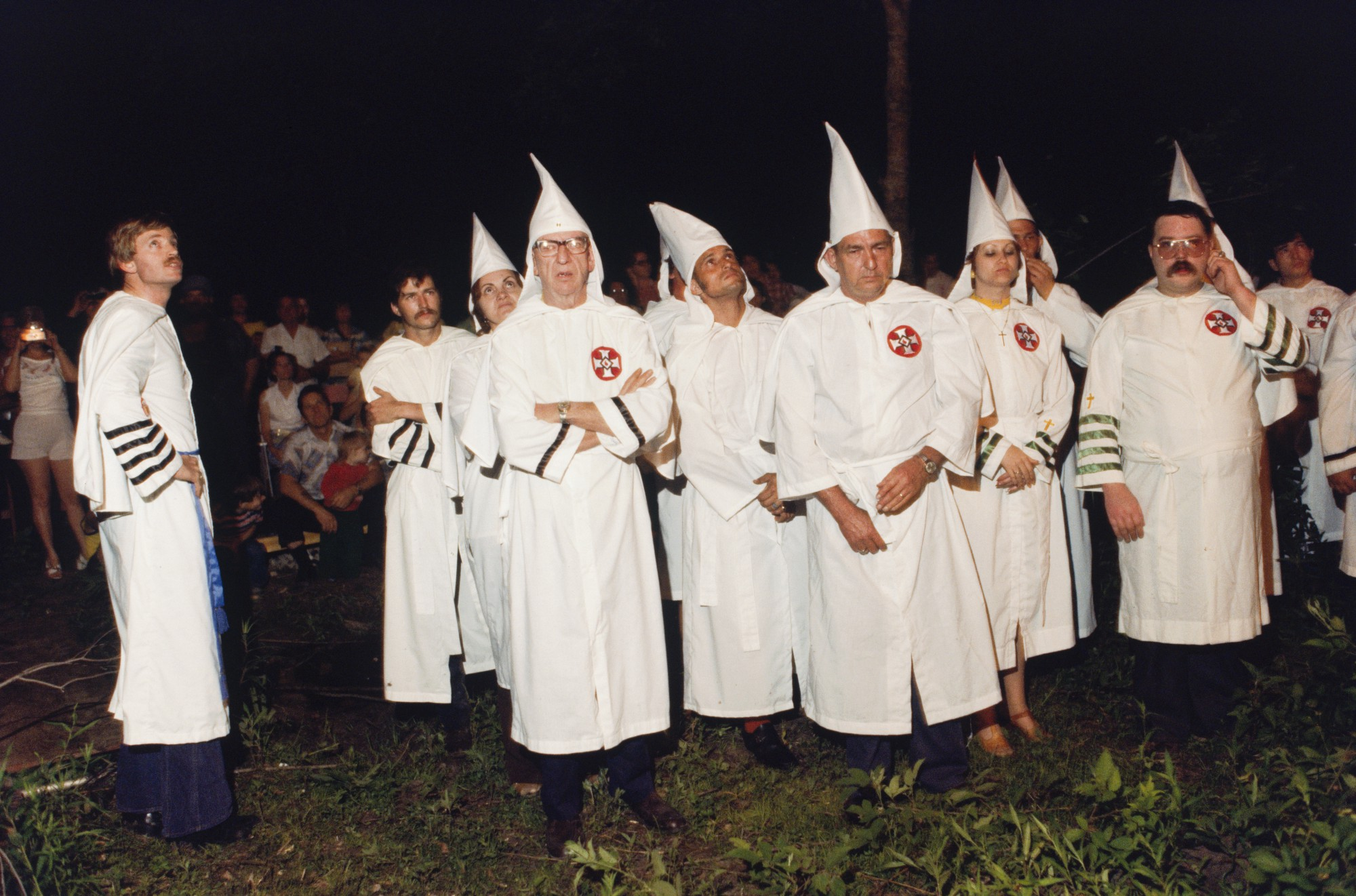 Why does the ku klux klan burn crosses they got the idea from a knights of the ku klux klan including grand wizard david duke left watch a cross burning on a louisiana farm in 19777 nathan benncorbis via getty biocorpaavc Images