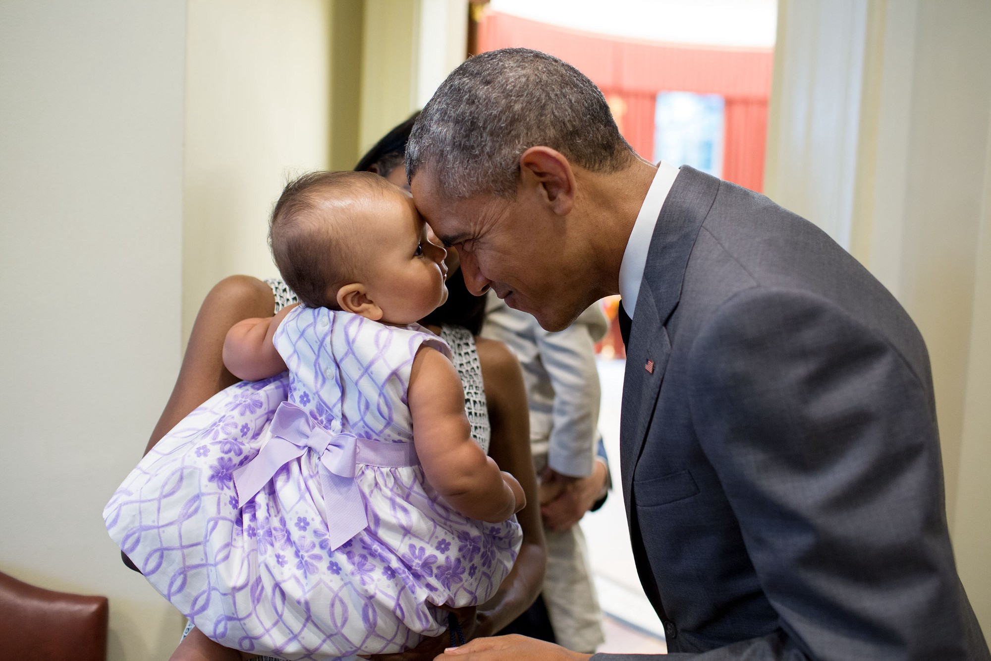 "July 17, 2015 ""The President greets nine-month-old Josephine Gronniger, whose father, Tim Gronniger, brought his family by the Oval Office for a family photo."" (Official White House Photo by Pete Souza)"