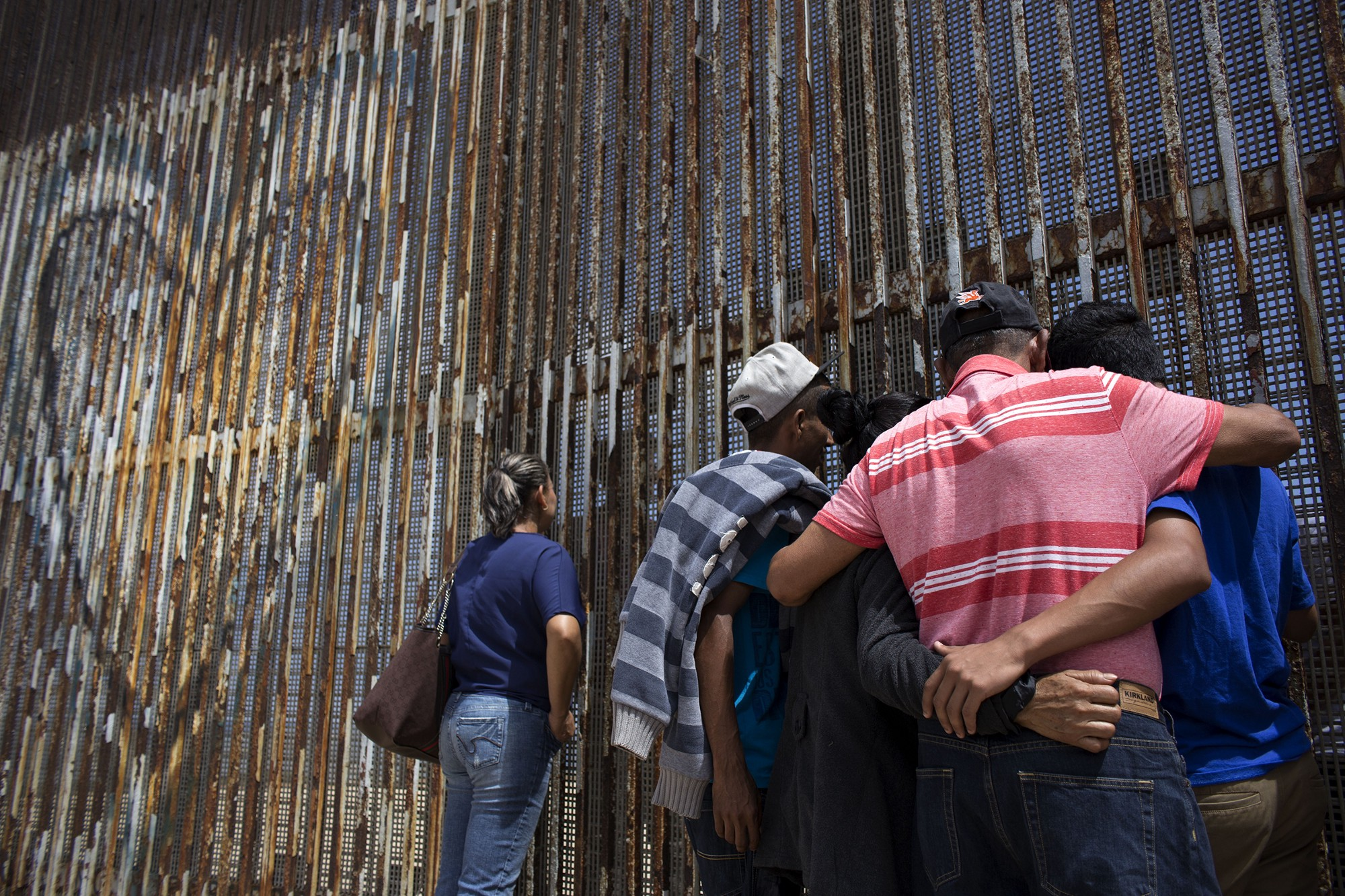 the molina torres family talk to their relatives through the usmexico border fence playas de tijuana in northwestern mexico 2016 guillermo