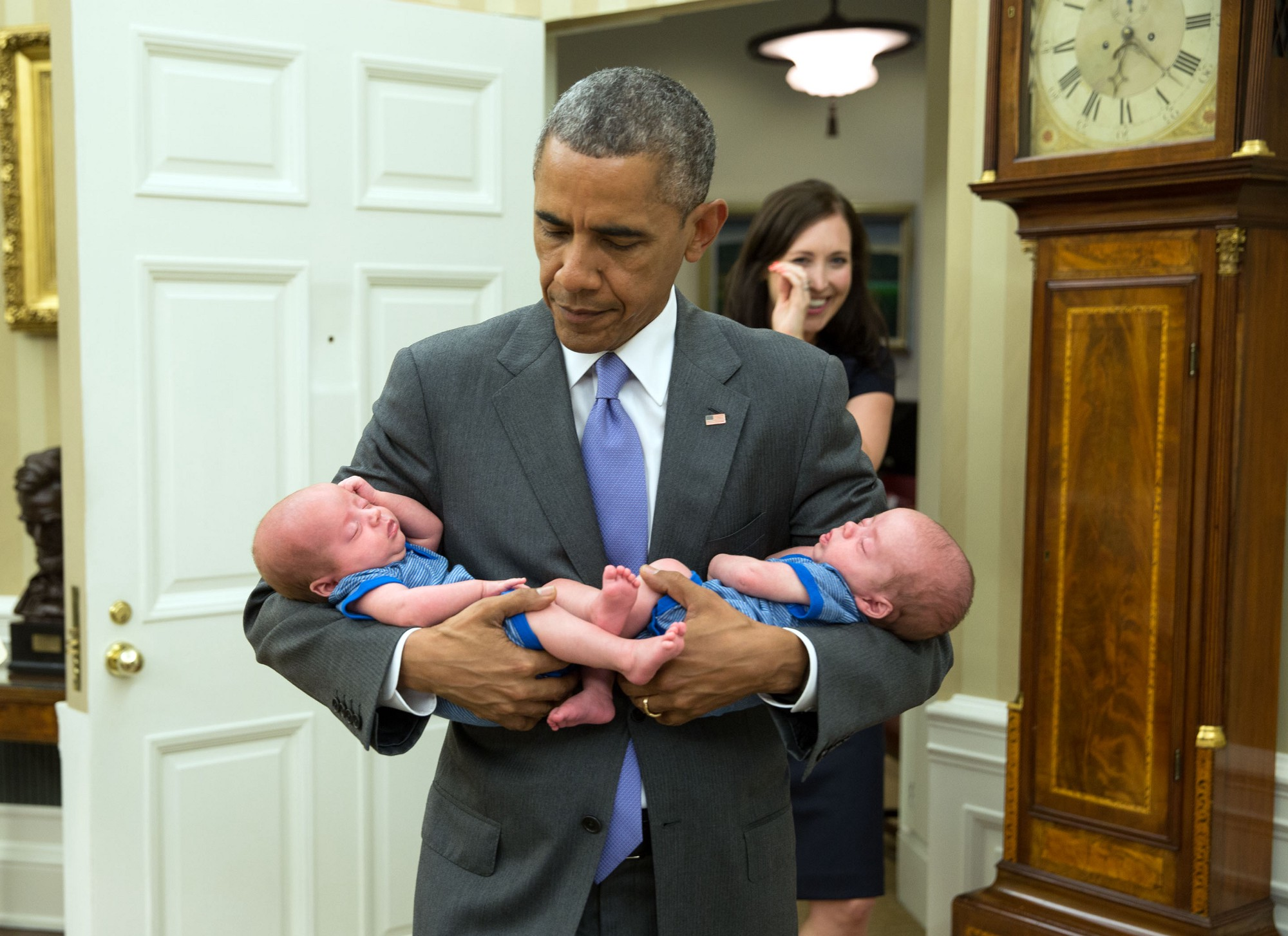 "June 17, 2015 ""The President carries the twin boys of Katie Beirne Fallon, Director of Legislative Affairs, into the Oval Office just a few months after they were born."" (Official White House Photo by Pete Souza)"