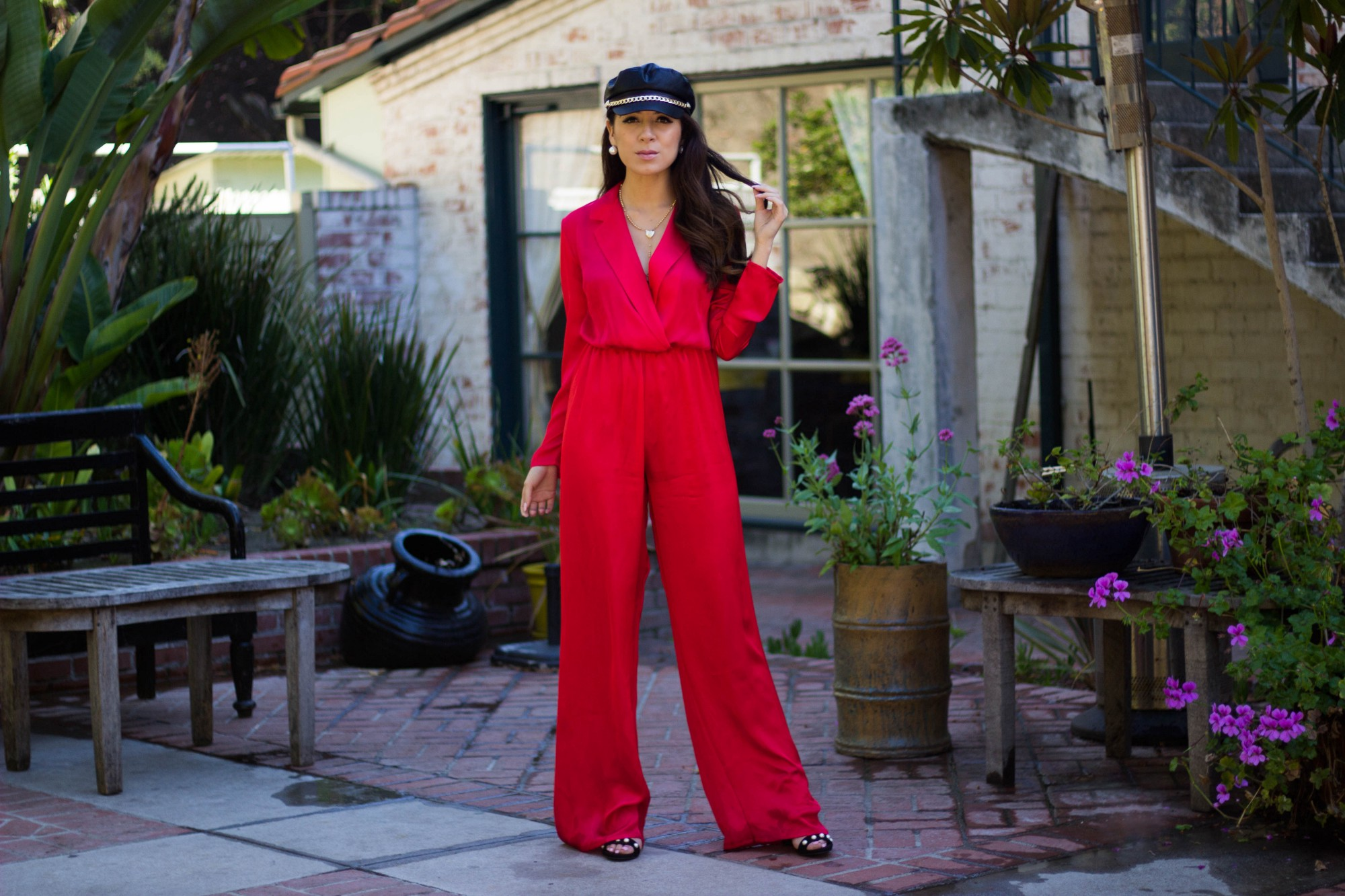 Jeniffer Avina wearing red silk jumpsuit