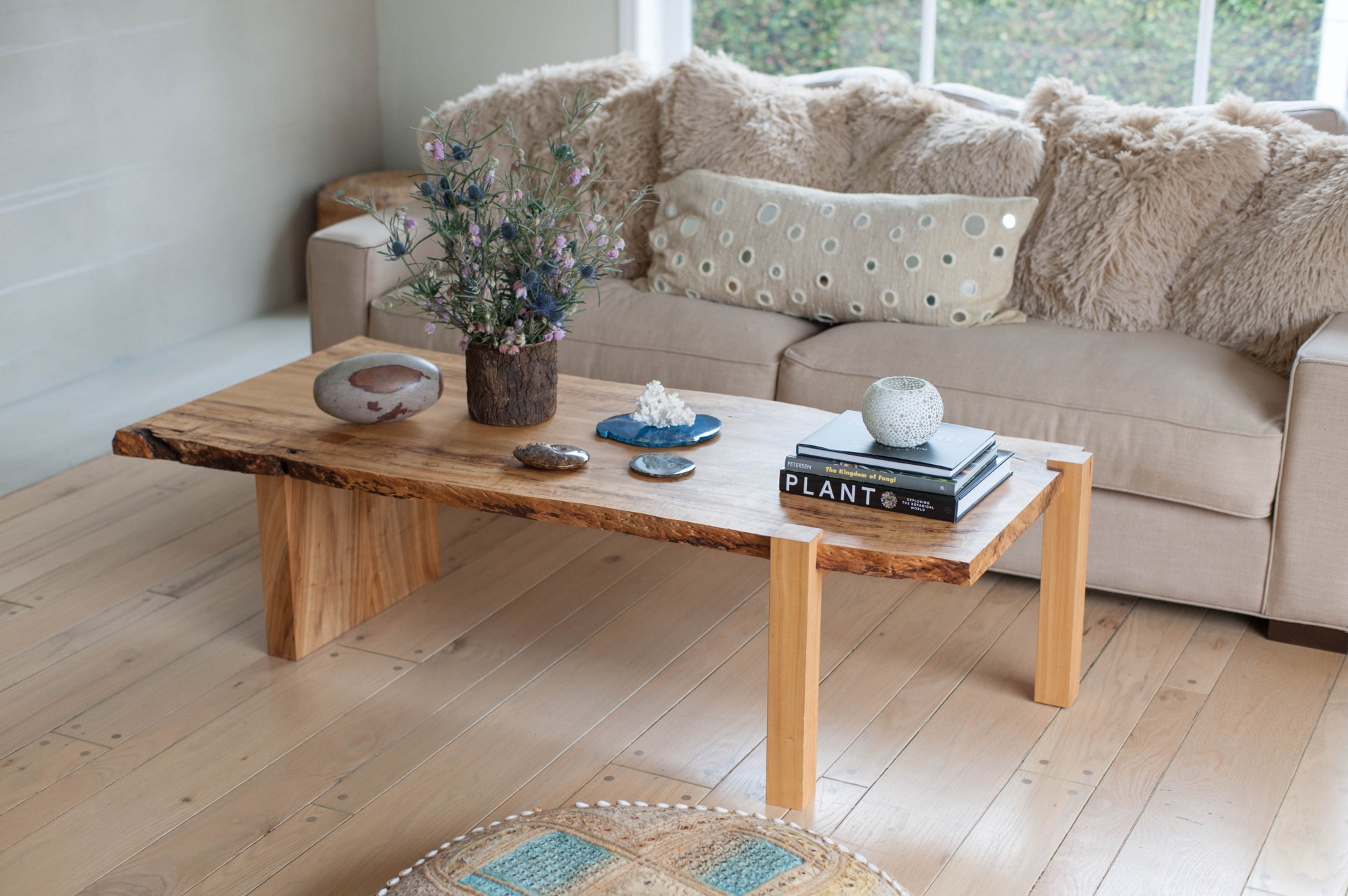 This all natural (non-toxic) sofa is paired with a handmade, live edge  coffee table featuring a collection of the homeowner's favorite things;  agate slices, ...