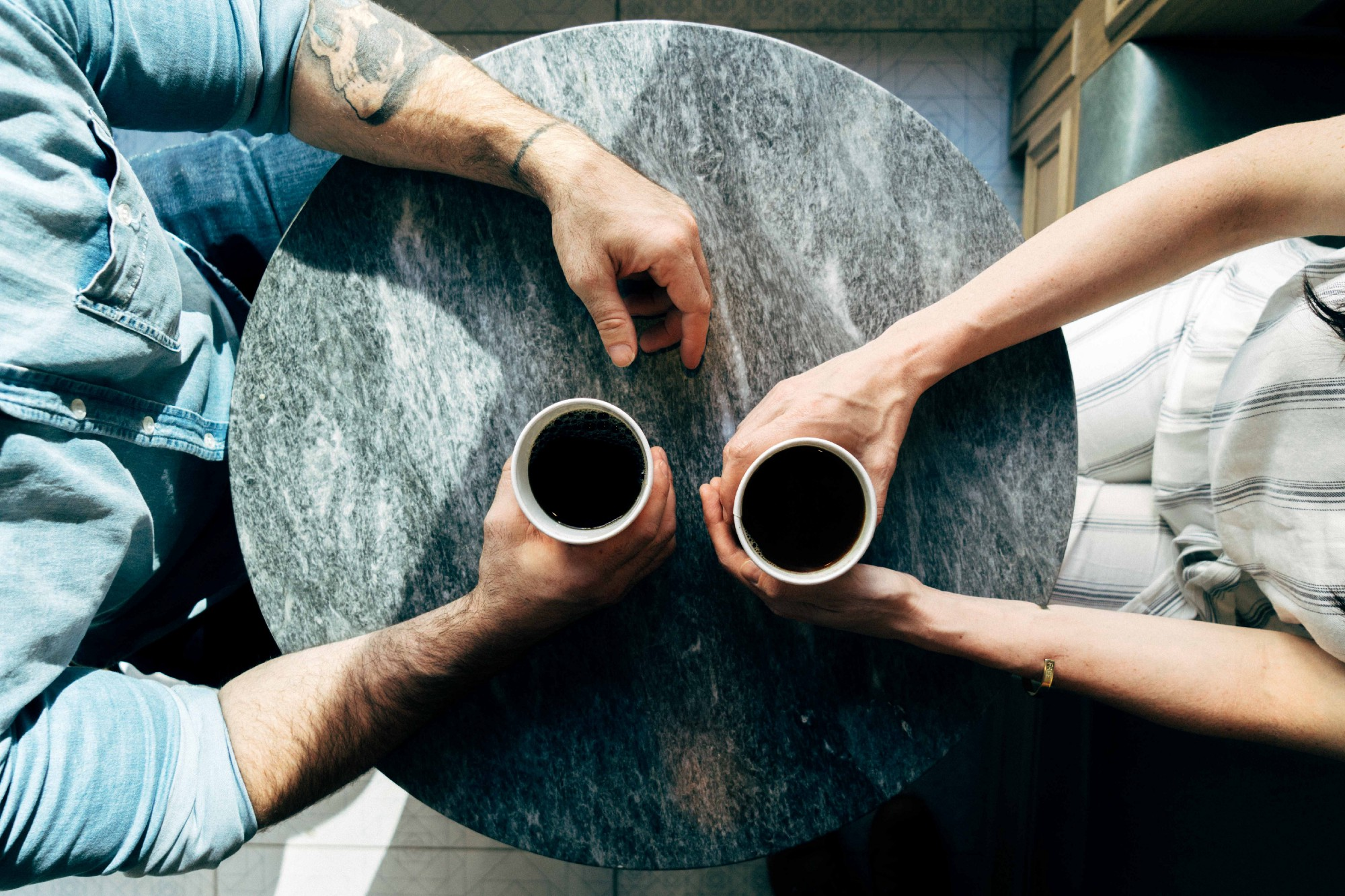 Couple sitting with coffee mugs