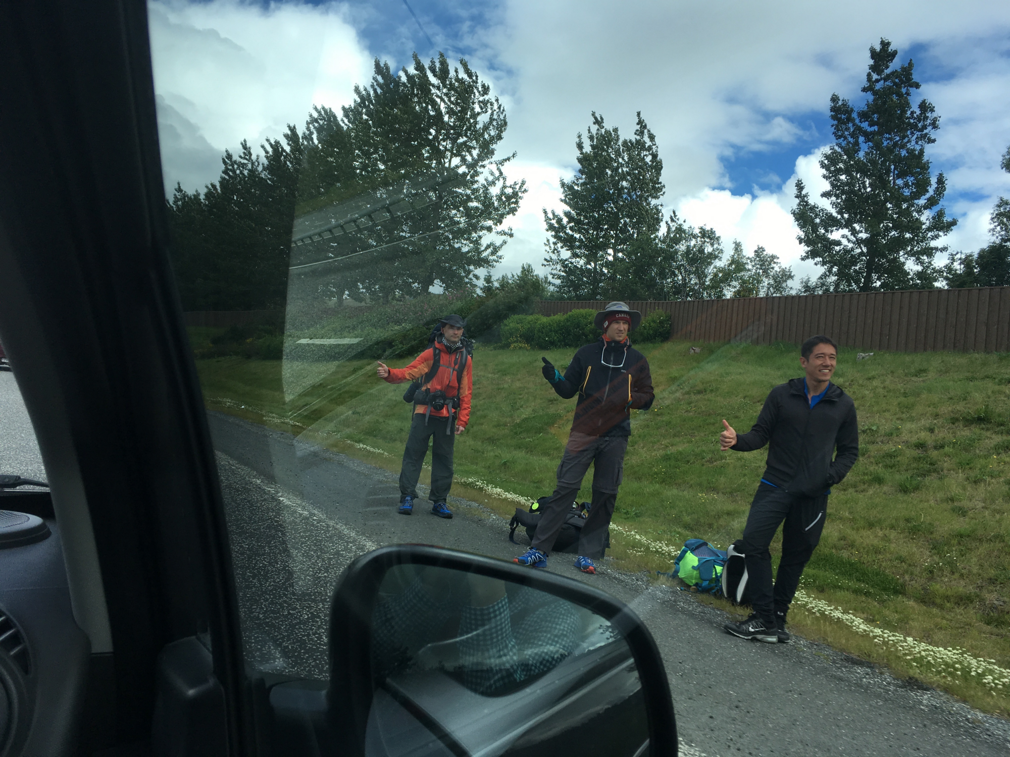 There are lots of hitchhikers in Iceland, like these friendly,  non-axe-murdering travelers I spotted outside of Reykjavik. Why don't we  pick one up?