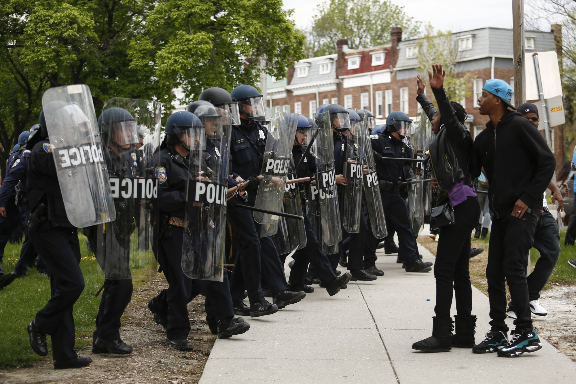 Baltimore police officers in riot gear push protestors back along - A Baltimore Police Officers In Riot Gear Push Protestors Back Along Reisterstown Road Near Mondawmin Mall April 27 In Baltimore Maryland