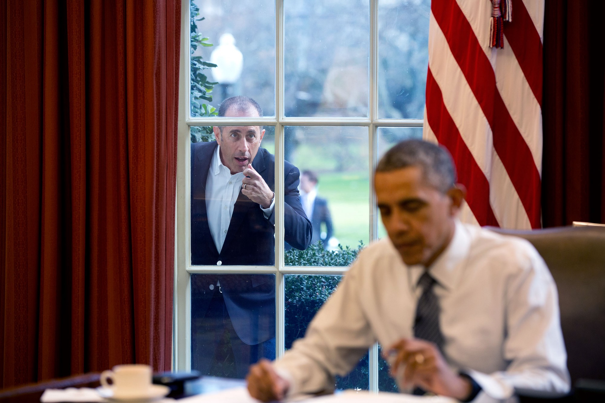 "Dec. 7, 2015 ""Comedian Jerry Seinfeld knocks on the Oval Office window to begin a segment for his series, 'Comedians in Cars Getting Coffee.'"" (Official White House Photo by Pete Souza)"
