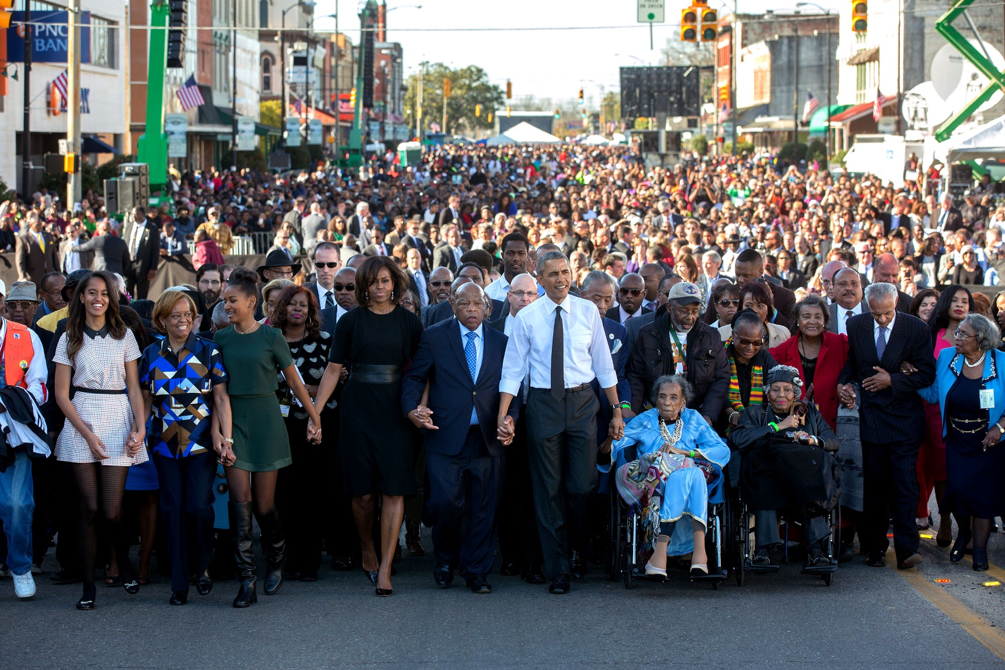 "March 7, 2015 ""For Presidential trips, I usually have another White House photographer accompany me so he or she can preset with the press and obtain angles that I can't, as I usually stay close to the President. Lawrence Jackson made this iconic image from the camera truck as the First Family joined others in beginning the walk across the Edmund Pettus Bridge."" (Official White House Photo by Lawrence Jackson)"