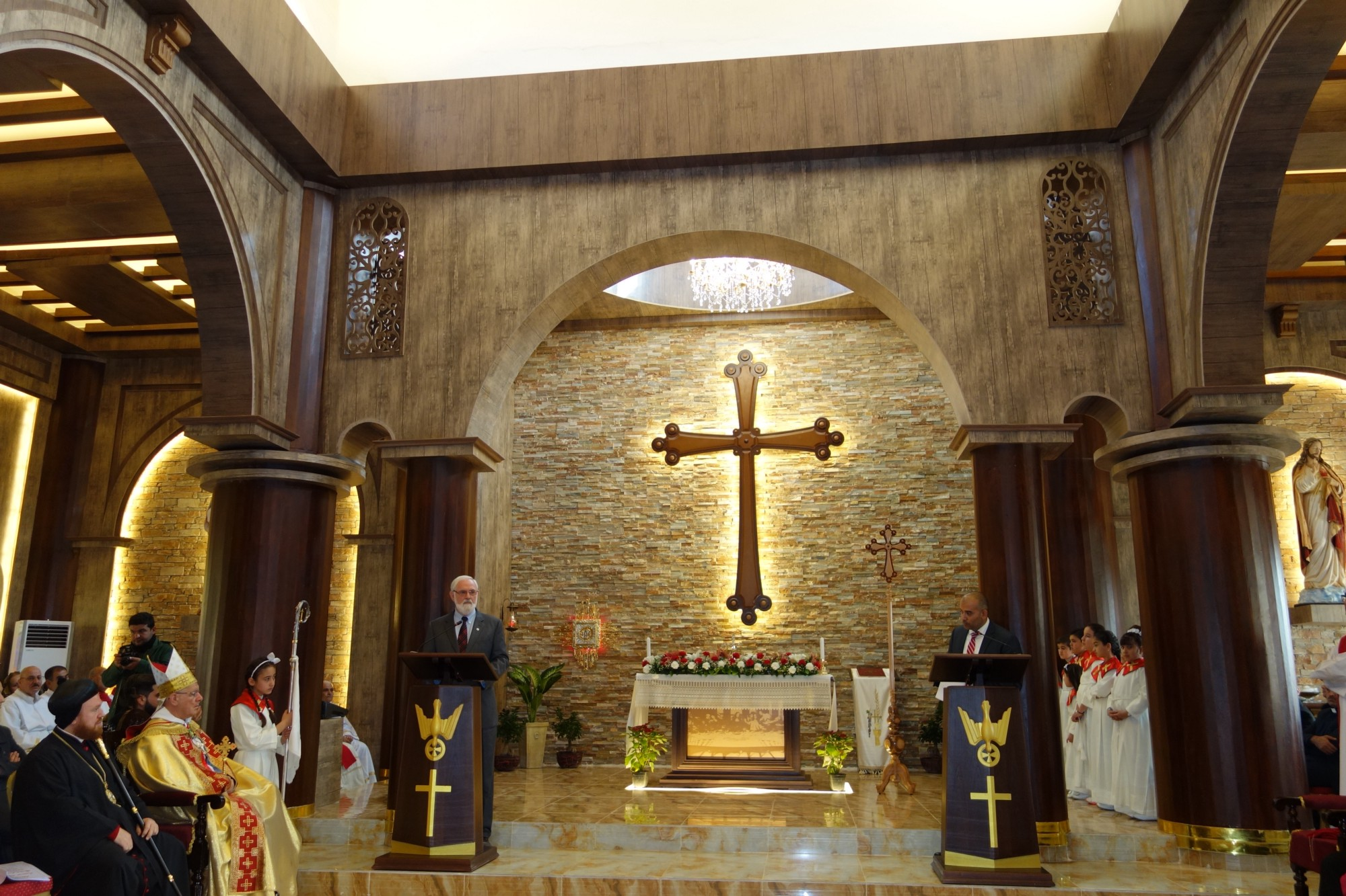 USAID Counselor Tom Staal attended the rededication of a refurbished Chaldean Catholic church, in the Ninewa Plains, that ISIS had looted and burned. He assured the congregation that the United States stands with them. / Nitika Sethi, USAID