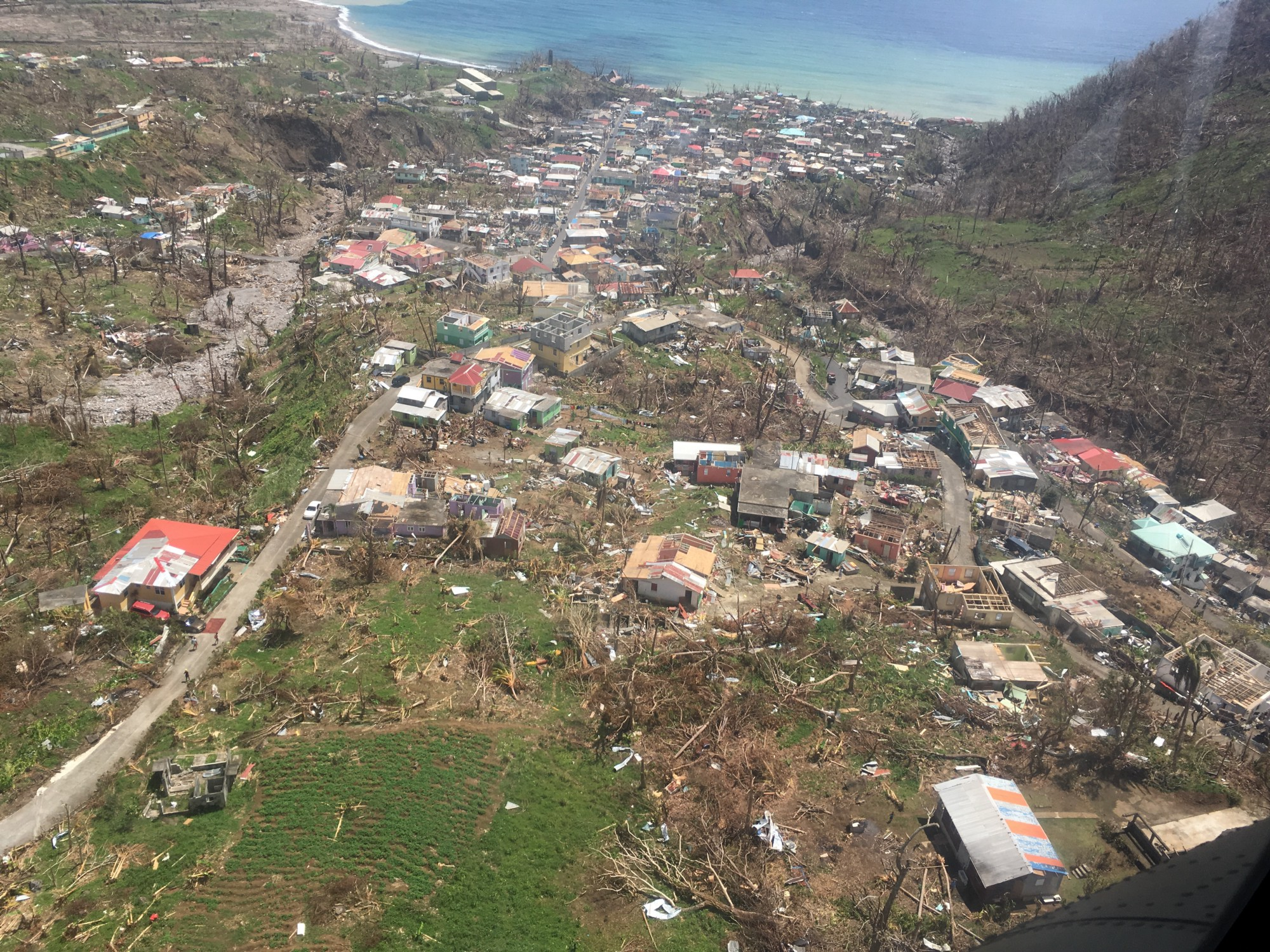 Hurricane Maria, a Category 5 storm, made landfall on the island of Dominica on September 18, causing widespread devastation. Photo credit: Caroline Ogonowski, USAID/OFDA