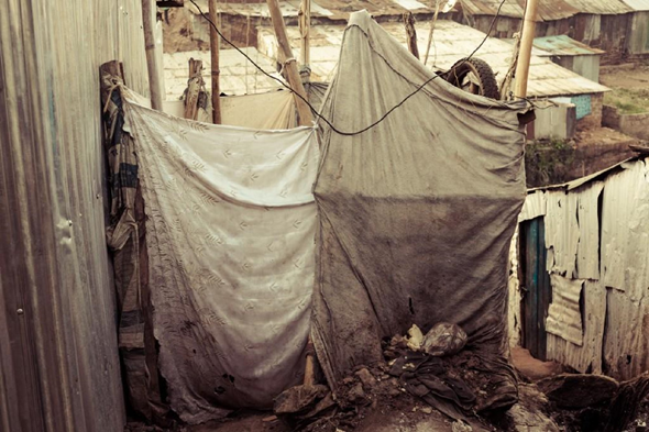 A communal shower, in the heart of the slum