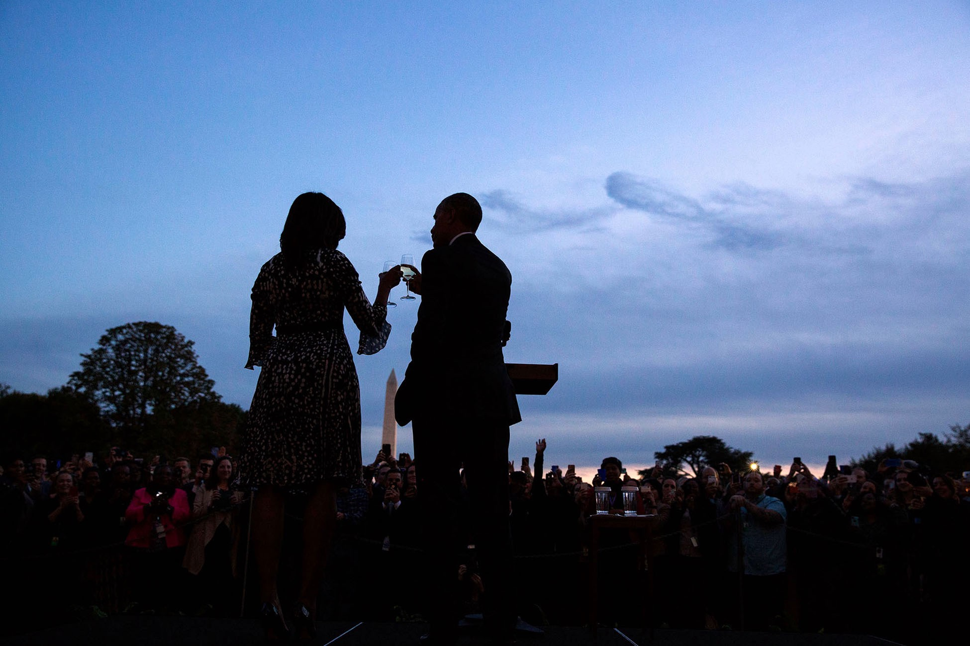 "Oct. 14, 2016 ""There was almost no light remaining at the end of the day when the President and First Lady walked out to the South Lawn for a 'Fourth Quarter' toast to White House staff."" (Official White House Photo by Pete Souza)"