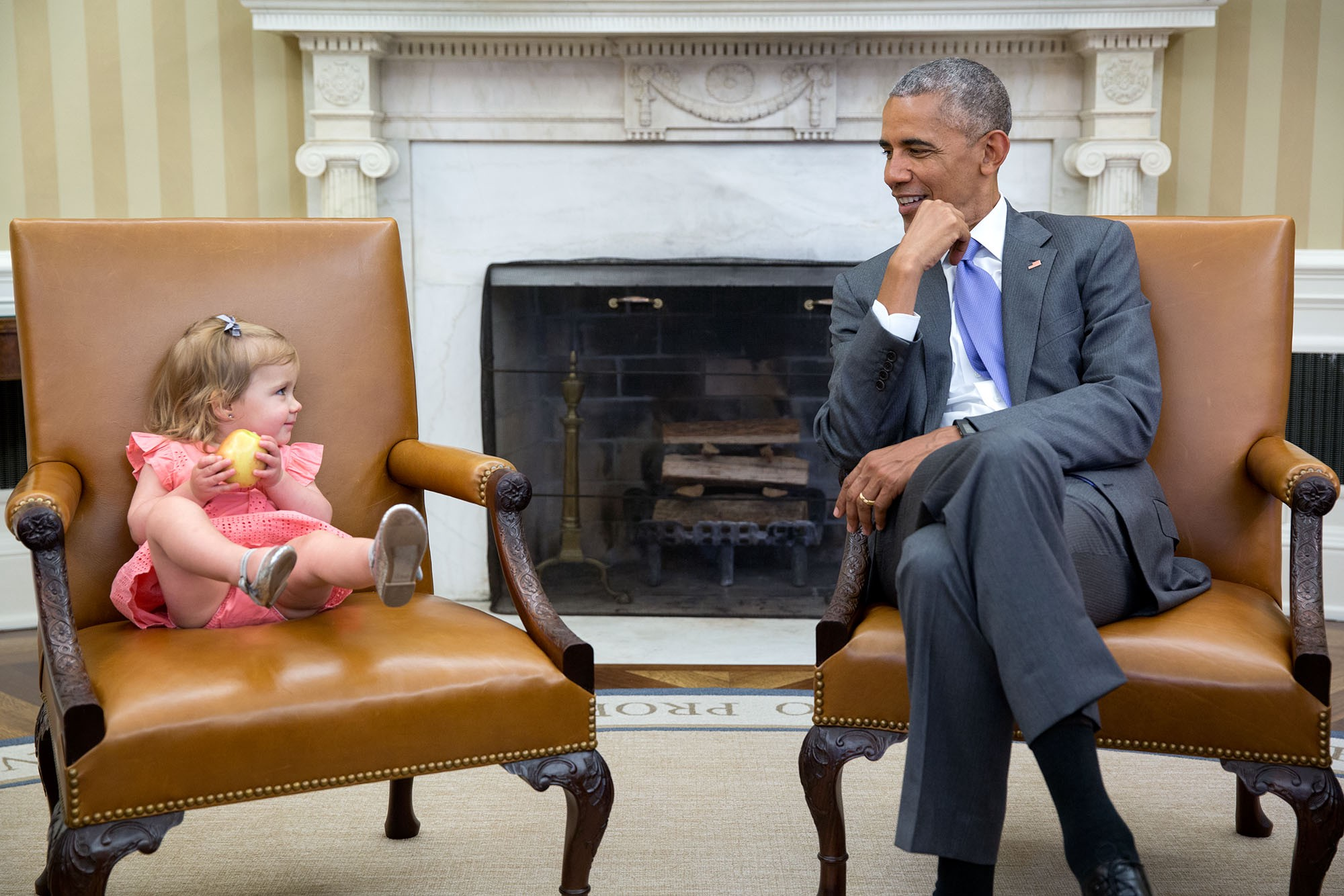 "June 22, 2016 ""The great thing about children is you just don't know what they will do in the presence of the President. So when David Axelrod stopped by the Oval Office with one of his sons' family, Axe's granddaughter, Maelin, crawled onto the Vice President's seat while the President continued his conversation with the adults. Then at one point, Maelin glanced over just as the President was looking back at her."" (Official White House Photo by Pete Souza)"