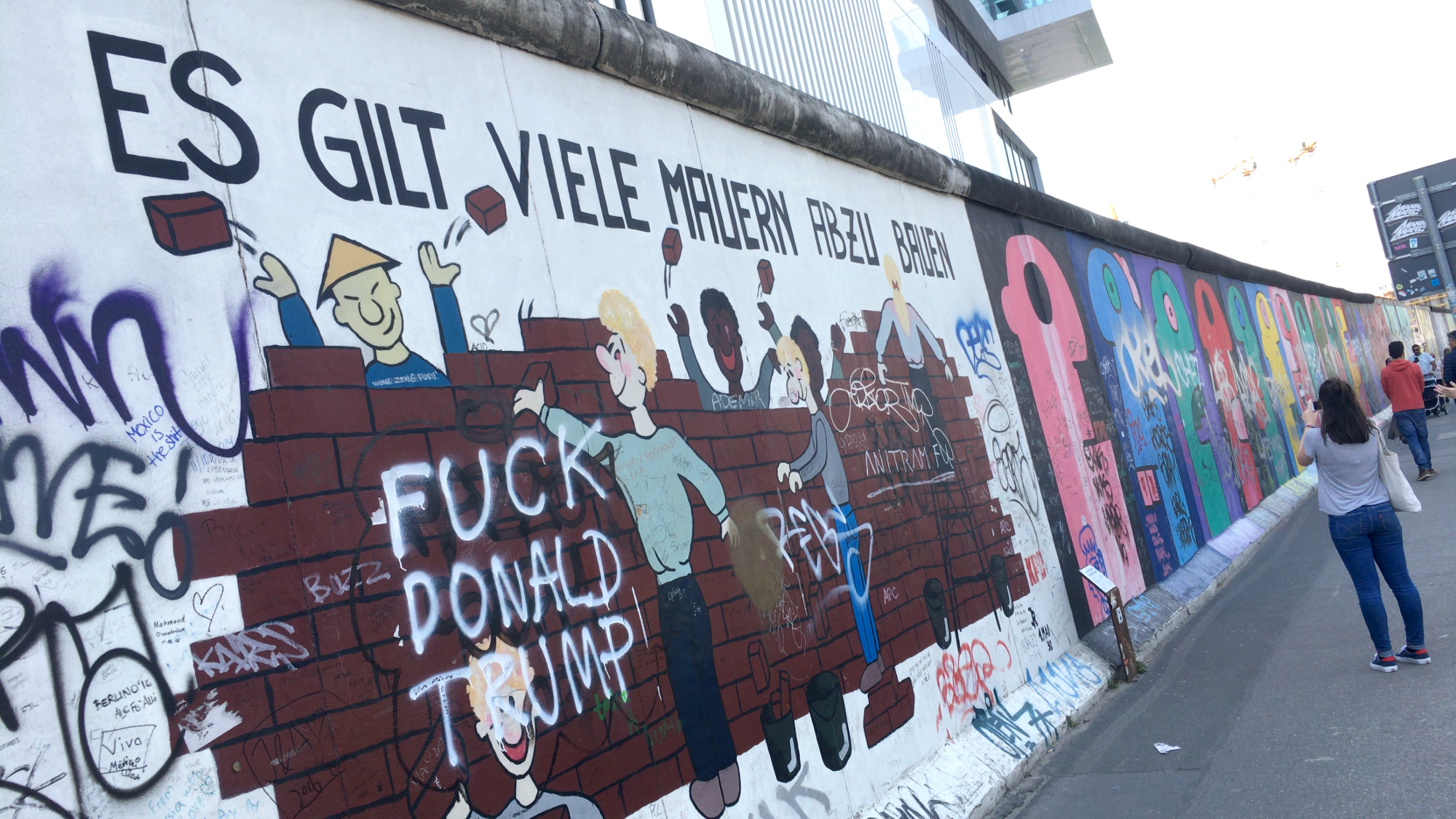 Artwork On The Last Remains Of The Berlin Wall Now Has A Security Fenceu2014and  Calls Out Donald Trump.
