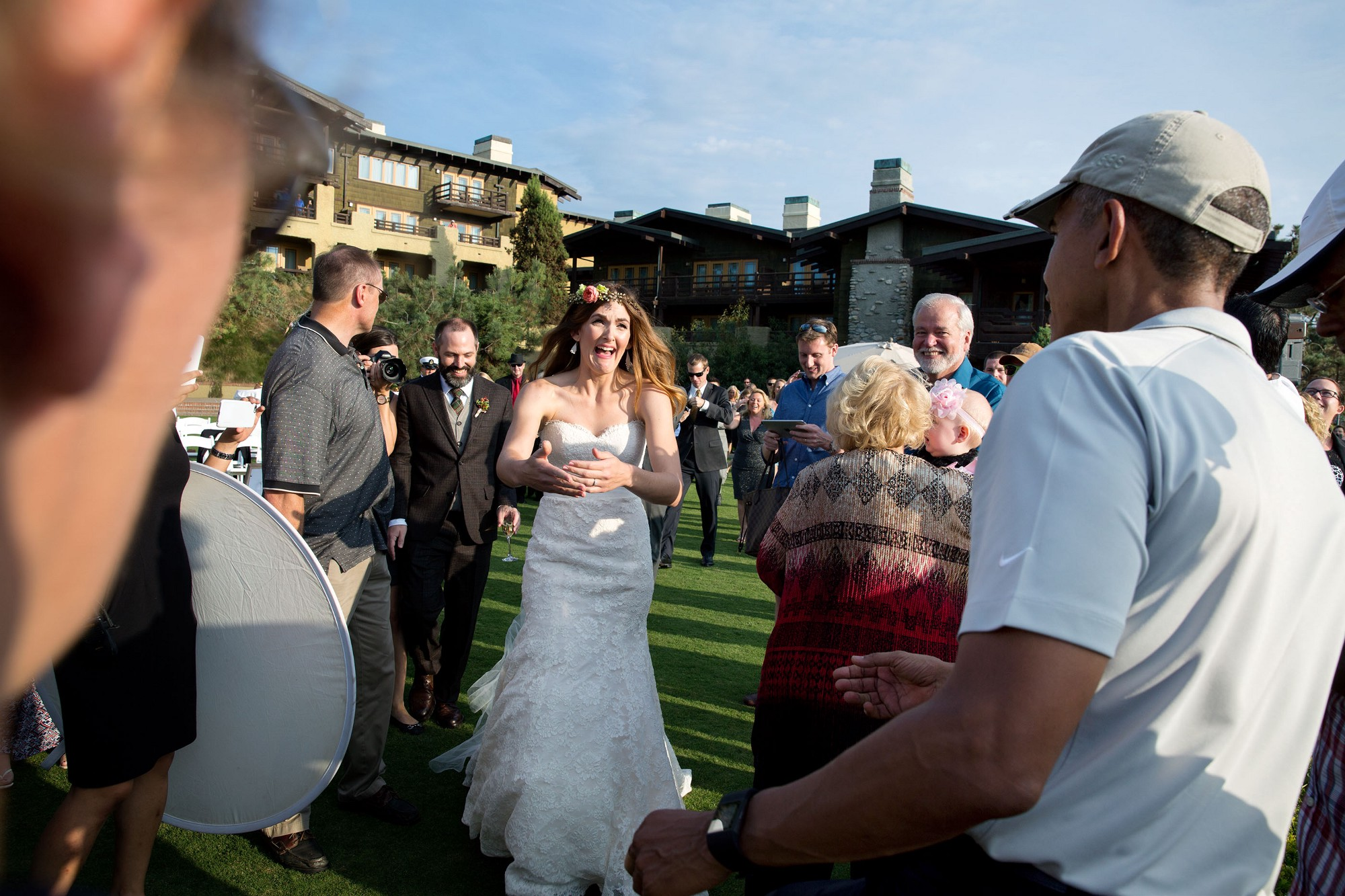 "Oct. 11, 2015 ""The President was playing golf at Torrey Pines Golf Course in San Diego, Calif. As he was finishing his round, he began to shake hands with guests waiting for a wedding ceremony about to begin. The bride and groom were waiting inside but when they looked out the window and saw the President, they decided to make their way outside. I made a grab shot as the bride, Stephanie Tobe, and her soon-to-be husband, Brian Tobe, came running to greet the President. I made sure to send a copy to the happy couple and both wrote back to me that they were extremely grateful to have the President 'crash' their wedding."" (Official White House Photo by Pete Souza)"