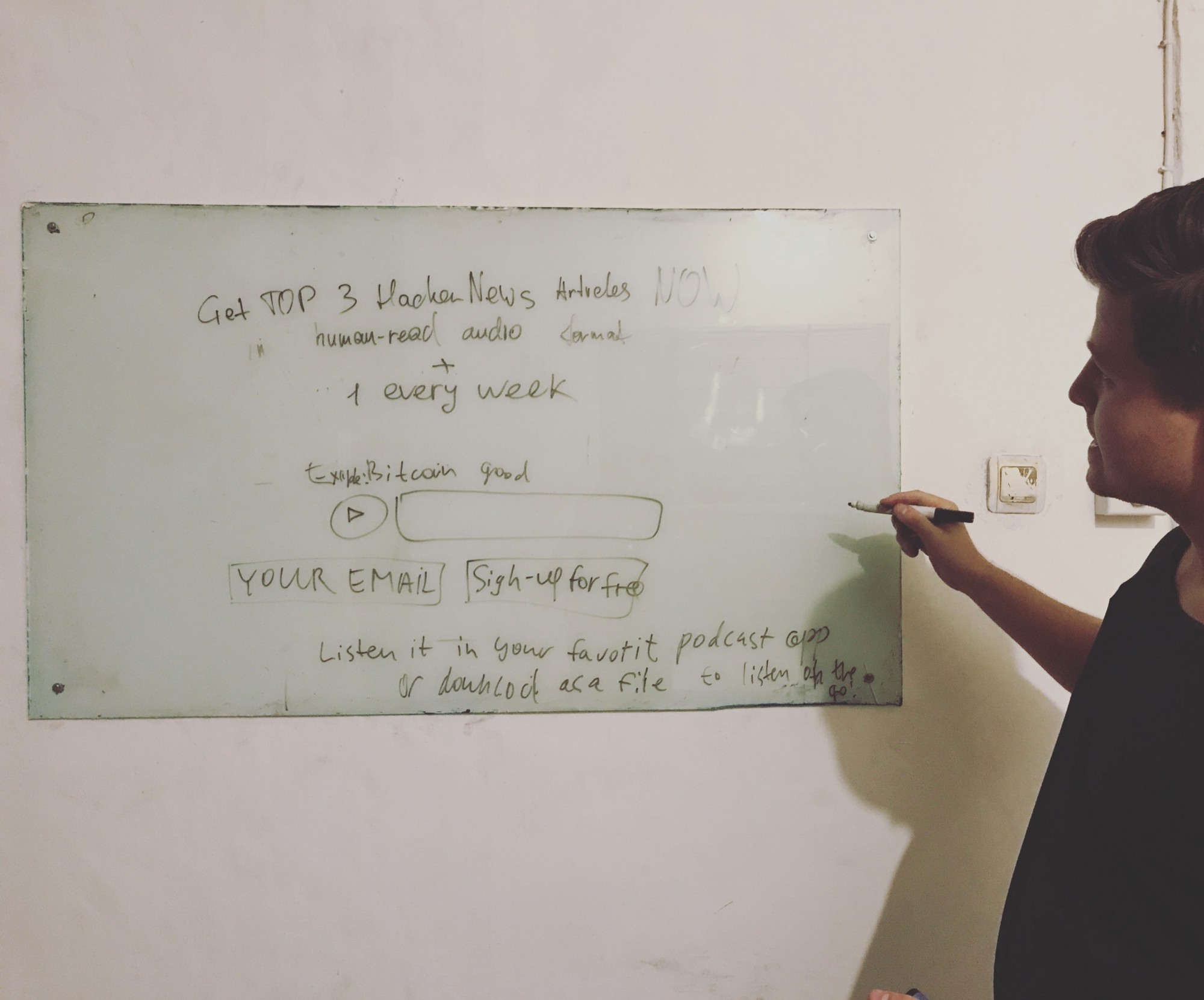 Raman drafting a landing page on a whiteboard