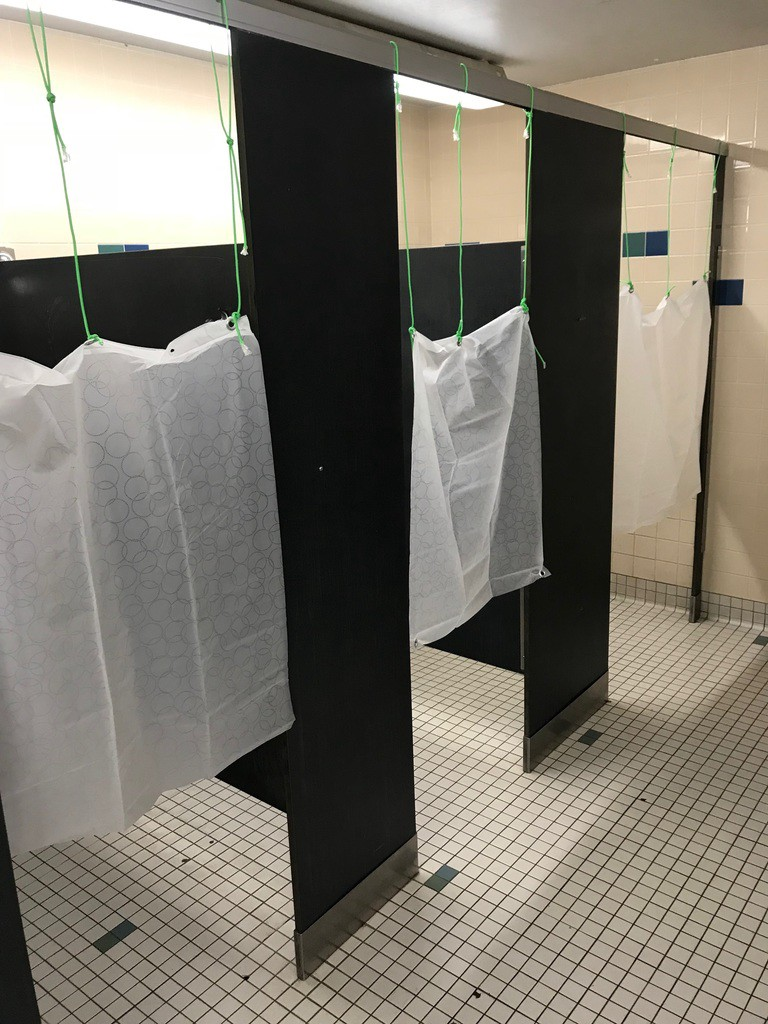 The new shower curtains that were installed at CCS in response to customer feedback.
