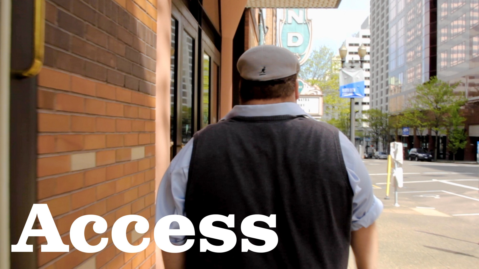 "Still shot of Cory's back walking down the street from movie ""Access"""