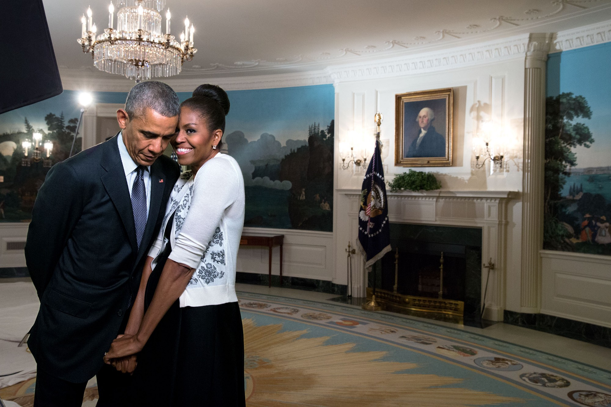 "March 27, 2015 ""The First Lady snuggled against the President during a video taping for the 2015 World Expo in the Diplomatic Reception Room of the White House."" (Official White House Photo by Amanda Lucidon)"