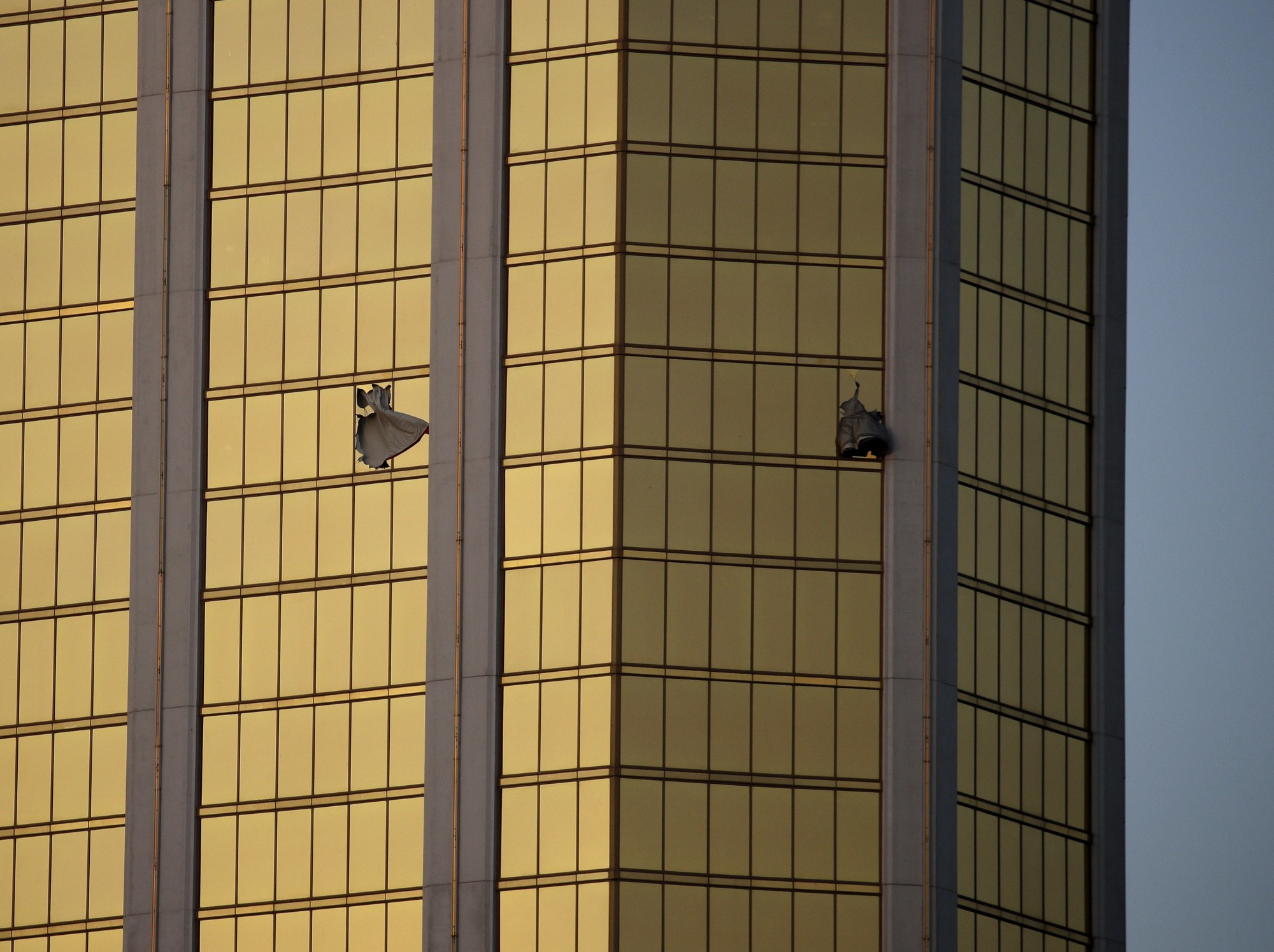 drapes billow out of broken windows at the mandalay bay resort and casino in las vegas on monday october 2 2017 following a mass shooting at a music