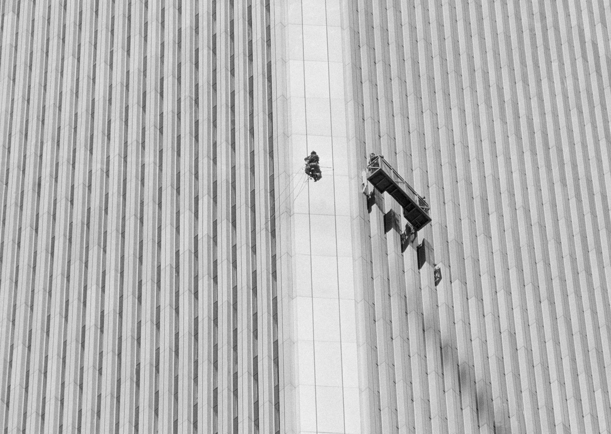 using an invention he fashioned himself george willig heads for the quarter mile high top of new yorks world trade center may 26 1977