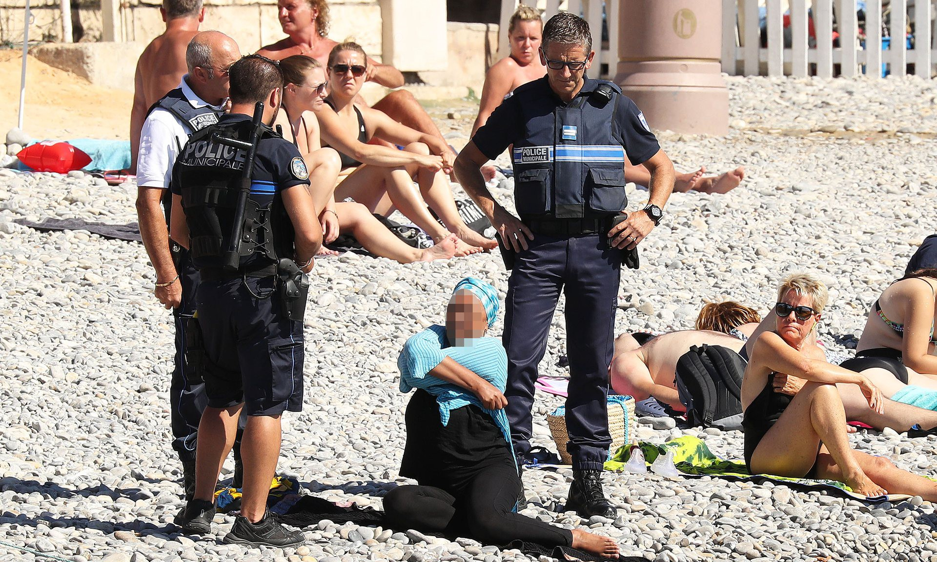 Woman forced to remove burkini in France