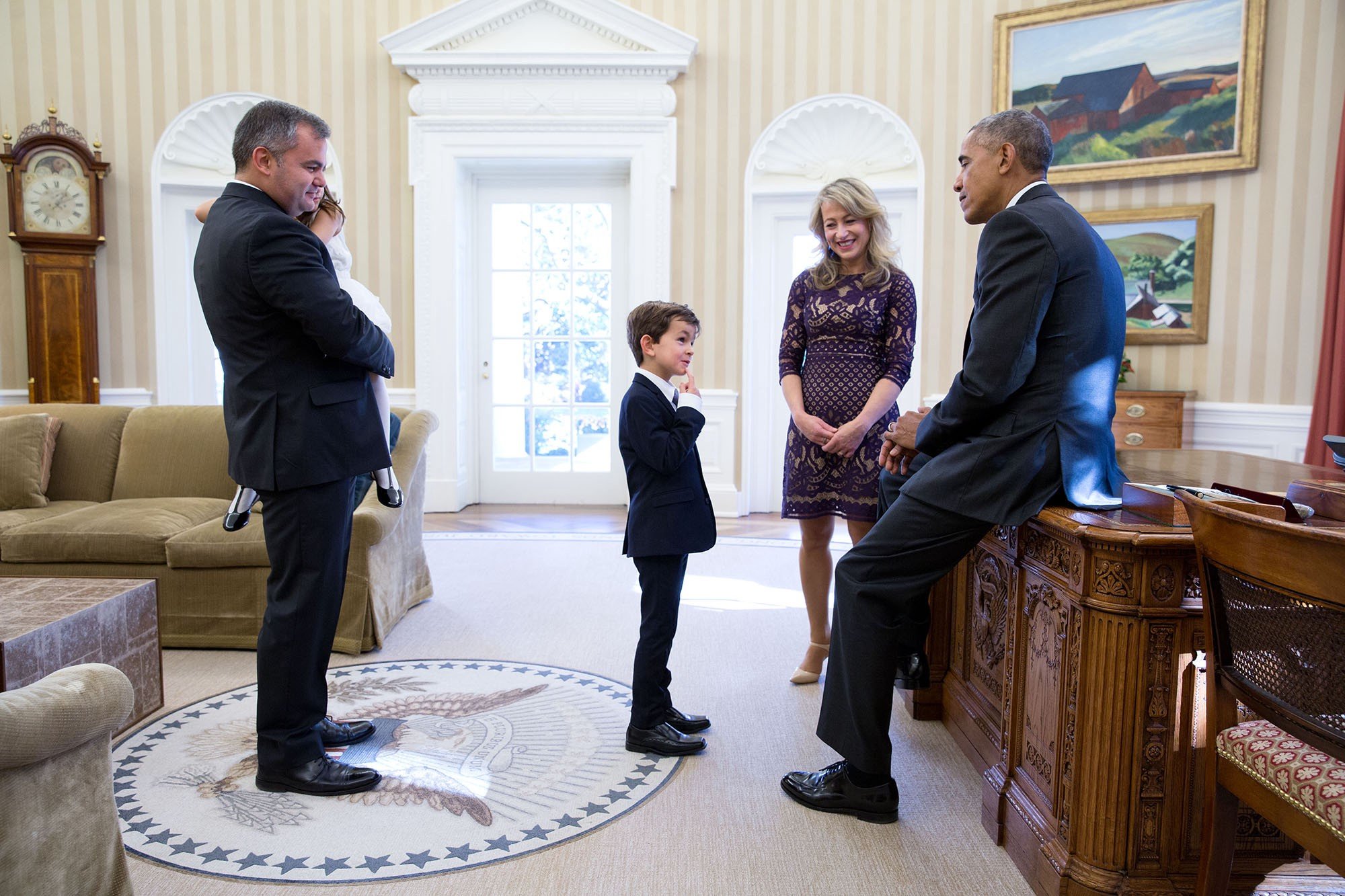 "Nov. 10, 2016 ""A good respite from the day after the election was the visit of Alex Myteberi. The six-year-old boy from New York had written a letter to President Obama after seeing a heart-breaking photograph of Syrian refugee Omran Daqneesh sitting silently in an ambulance, covered in blood and dust, after an air strike on Aleppo. In his letter, Alex wrote to the President: 'Can you please go get him and bring him to my home. We'll be waiting for you guys with flags, flowers, and balloons. We will give him a family and he will be our brother. The President was so touched by the letter that he read excerpts from it at the United Nations in September. Alex and his family were invited to the Oval Office so the President could tell him in person how much the letter had meant to him."" (Official White House Photo by Pete Souza)"