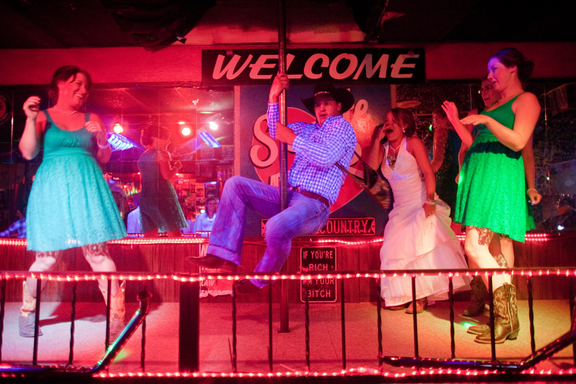 A Wedding Party Finds Its Way To The Stage At Skylite Bar In Valentine,  Neb., On June 14, 2014. Photo: Andrew Dickinson.