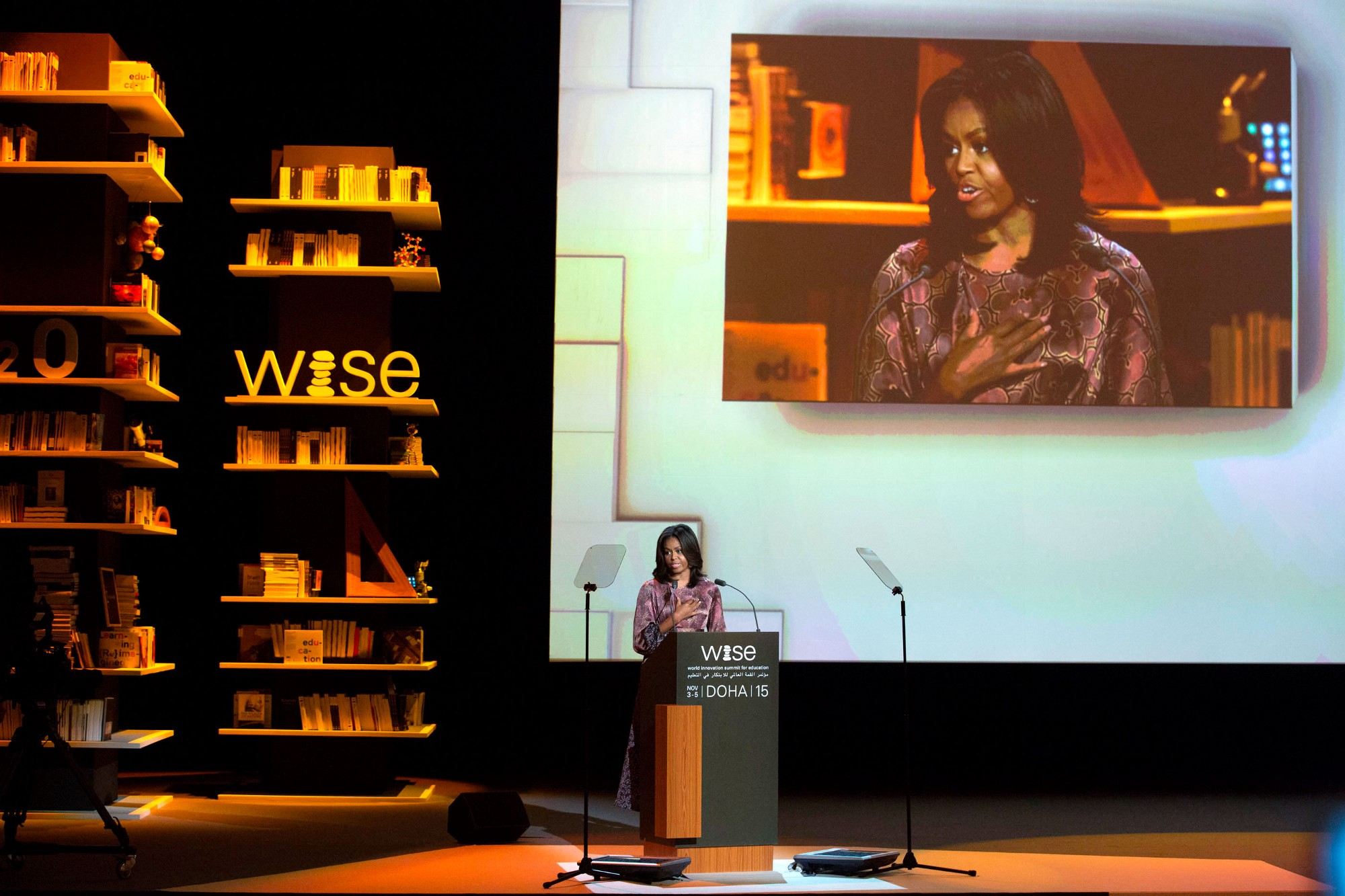 Michelle Obama speaking on stage at the World Innovation Summit for Education
