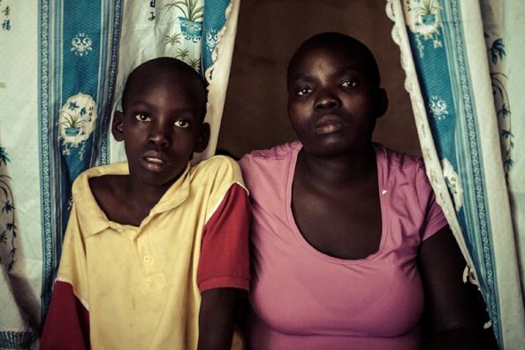 Elvis Omondi, 11 years old and her mother, Lucy Amino