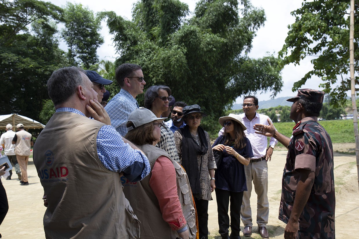 At the border, USAID Administrator Mark Green, third from left, heard from Border Guards Bangladesh about the waves of people fleeing violence in Rakhine for the safety of Bangladesh. Thankfully, they opened the border and allowed people to seek safety. (Anna Slattery, USAID)