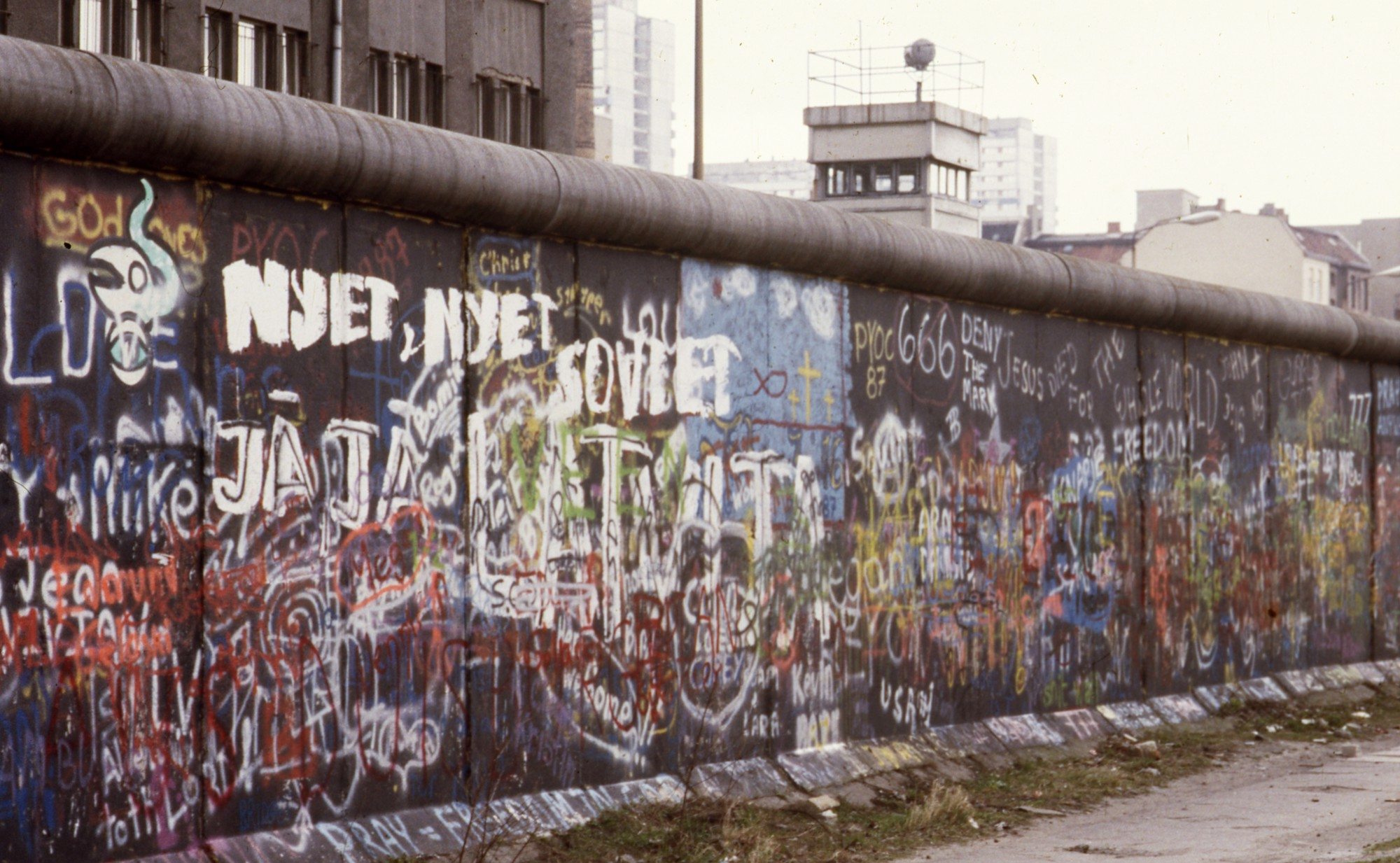 this photographer u2019s collection of berlin wall graffiti photos show the politics of paint