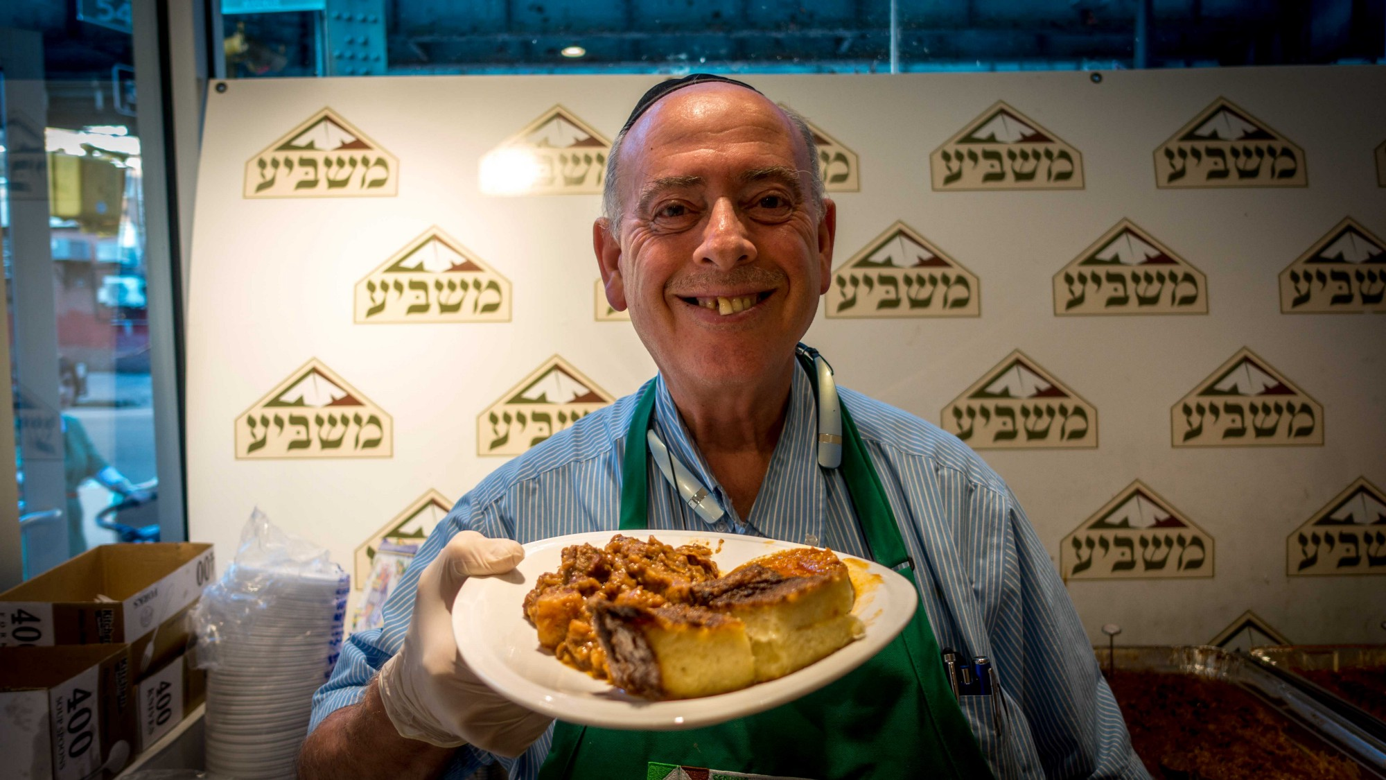 A.B. Grinspan serves a kosher meal at Masbia's Brooklyn soup kitchen. (Erin Riglin/Columbia News)