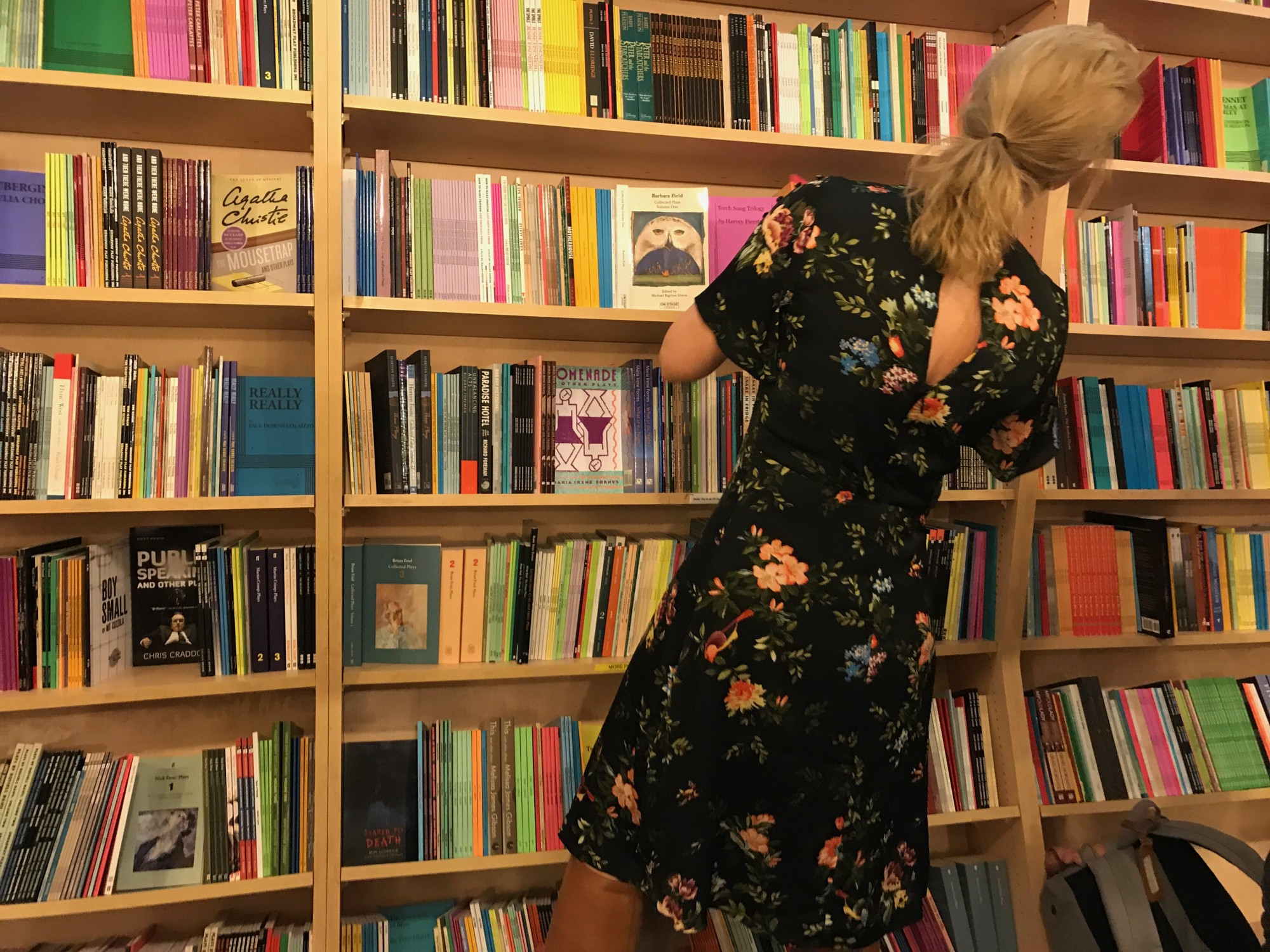 Woman Searches Through A Bookshelf At The Drama Book Shop In Times Square Manhattan NY Photo By Amanda Faye Rosengarten