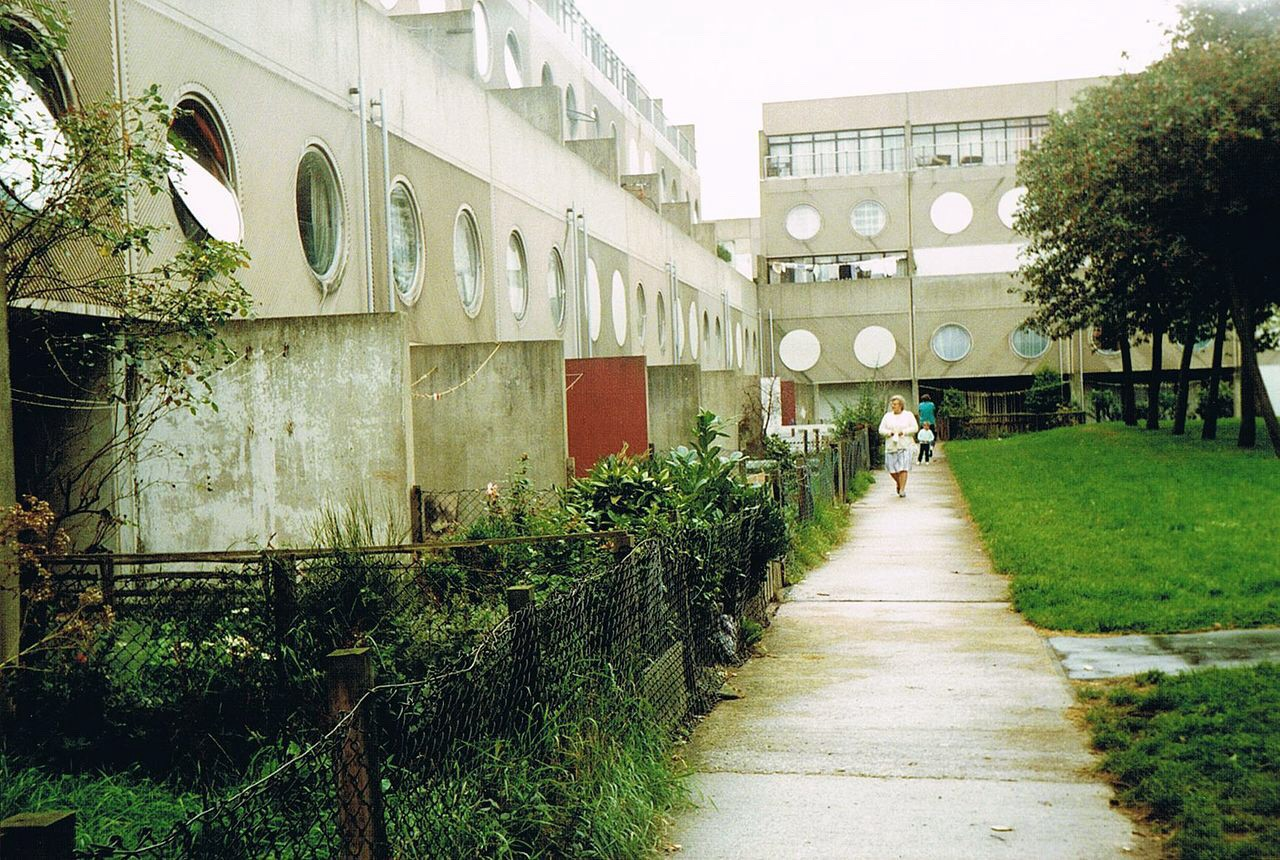 Picture of the estate with concrete buildings and porthole windows