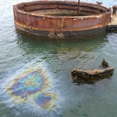 The gun turret and leaking oil from the sunken Arizona