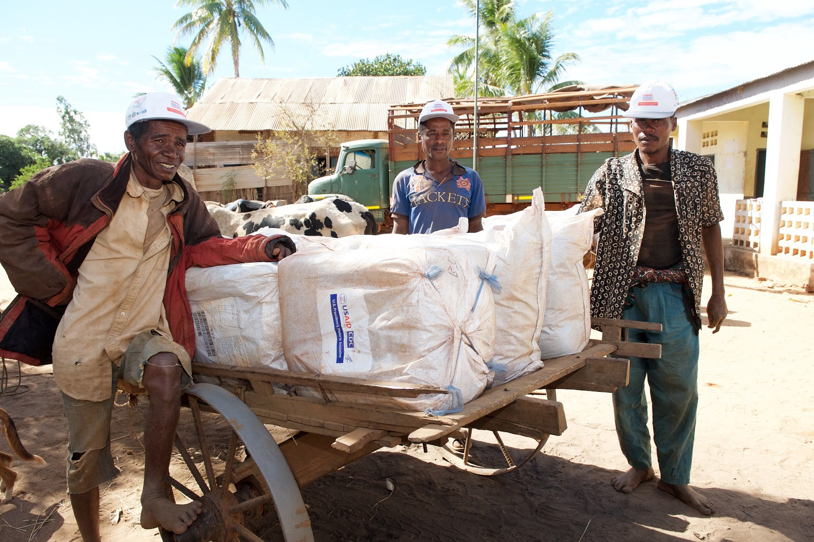 Malagasy men load malaria bed nets onto a cart in preparation for distribution. / Lan Andrian, USAID Global Health Supply Chain Program — Procurement and Supply Management