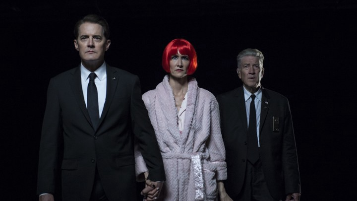 Agent Dale Cooper, Diane, and Gordon Cole in dark passage