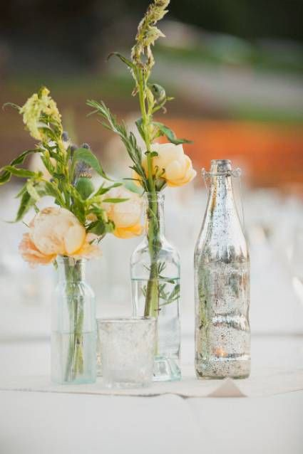 Reused glass bottle as a flower vases