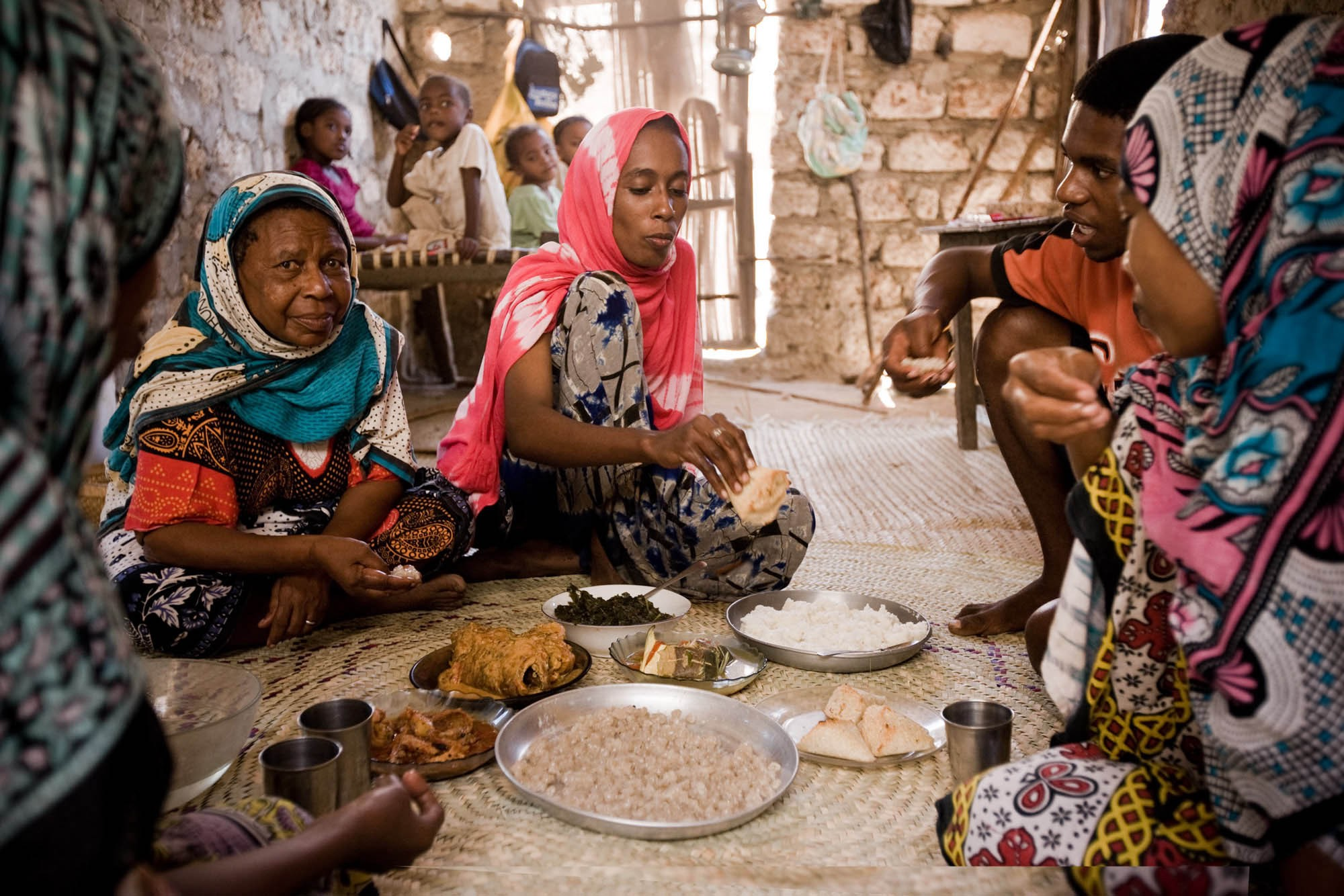 The Mohammed family serves lunch at their coral stone house in the fishing village of Kipangani. | © James Fisher 2017 All Rights Reserved.
